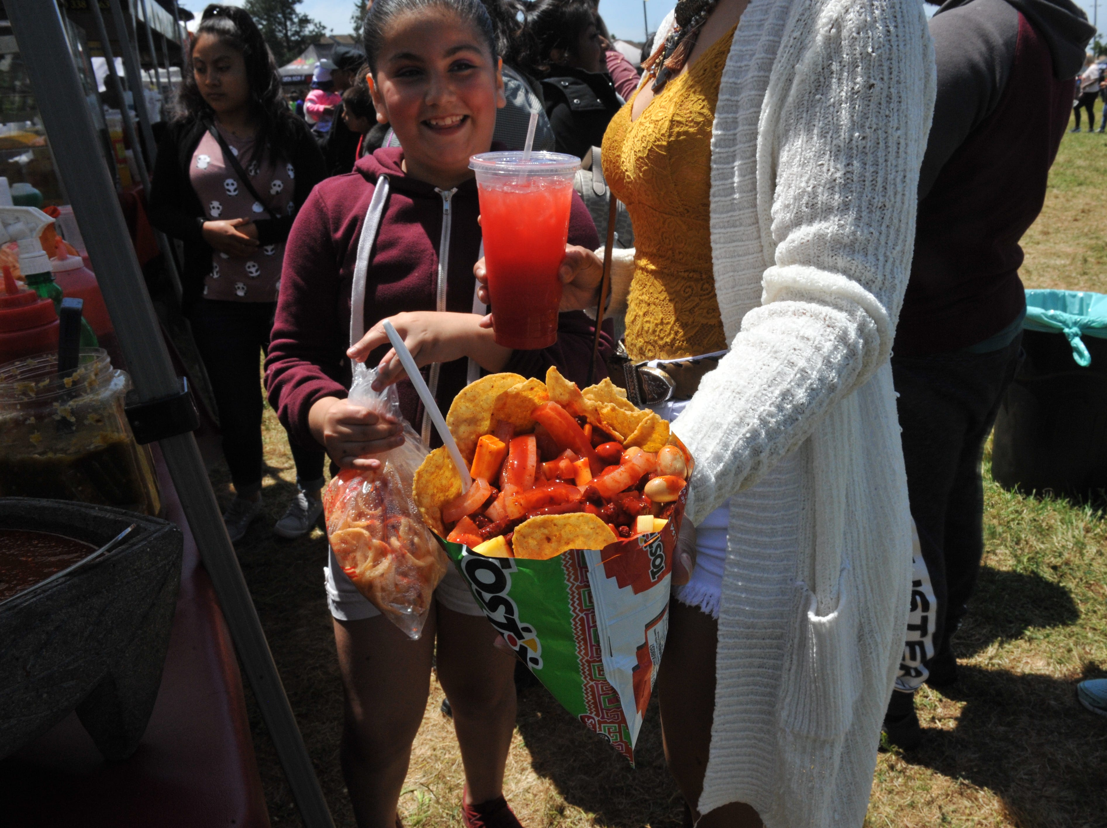 An order of Tostilocos, chips with fruits, Japanese peanuts and pickled pork skin, is served by Kings + Queen Beverages at the Salinas Día Del Niño on April 28, 2019.