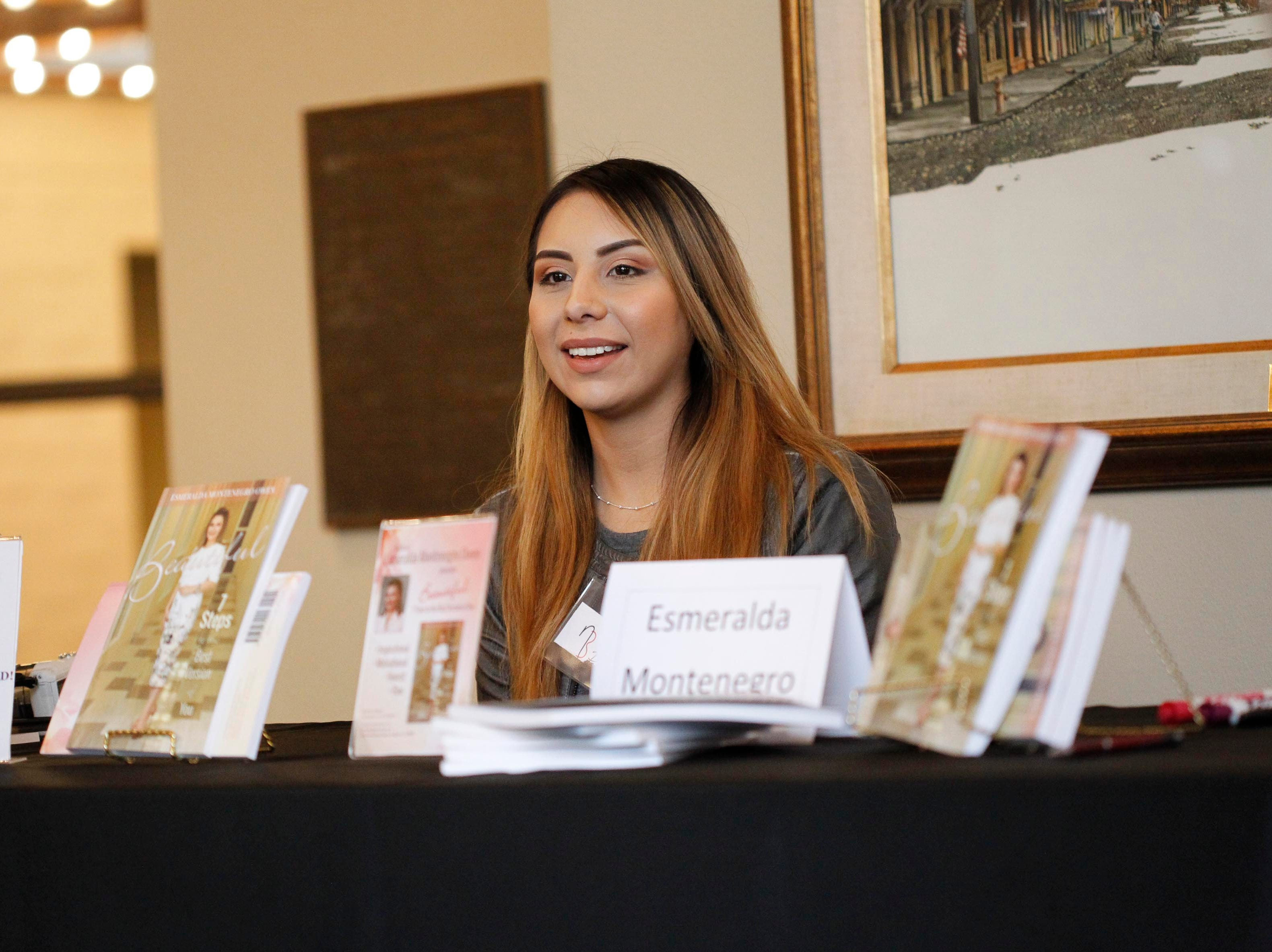 A woman sits at the booth of author Esmeralda Montenegro Owen of Salinas during the 12th annual Noche Bohemia at Sherwood Hall on Saturday, April 27, 2019 in Salinas, Calif.