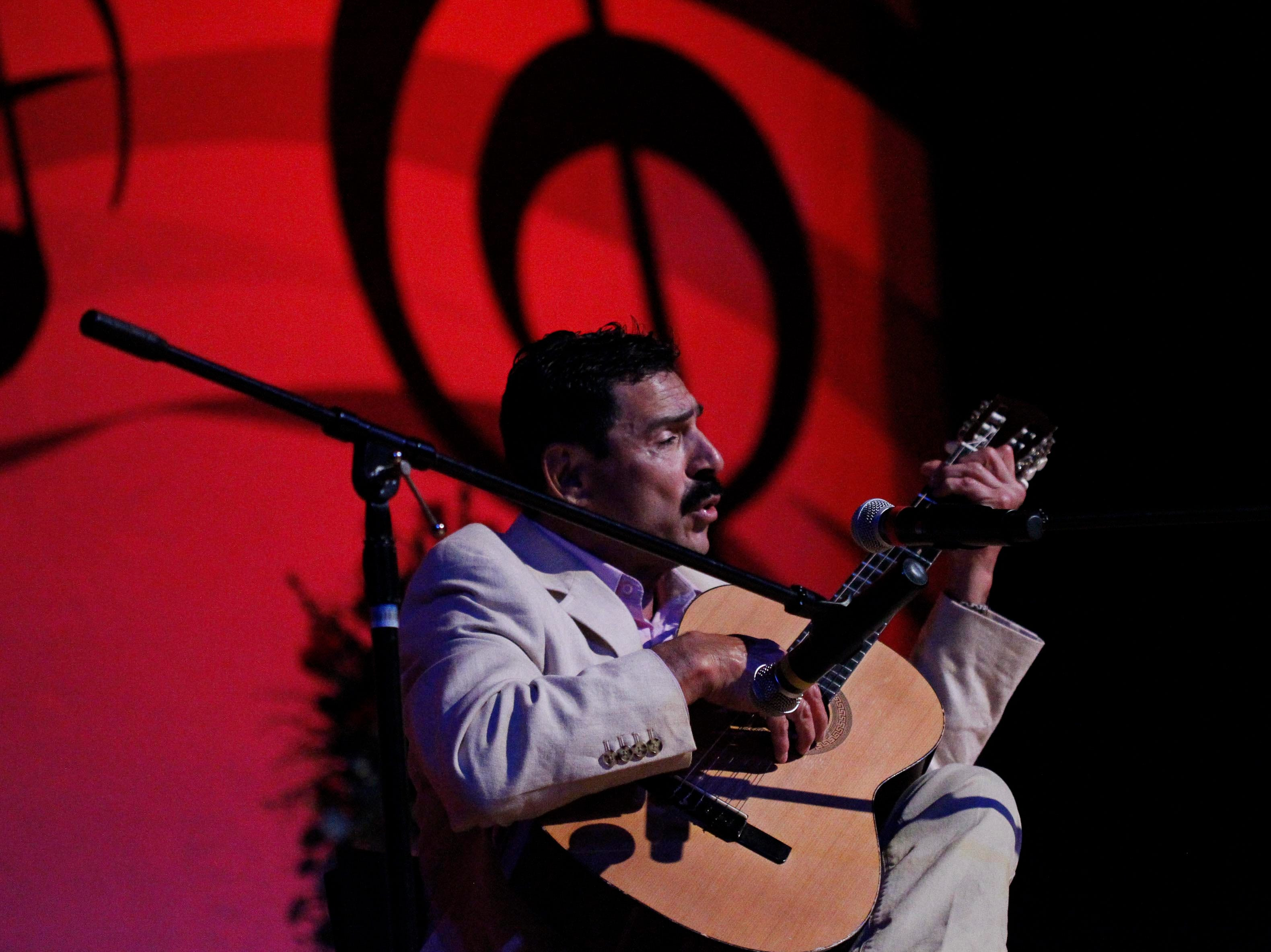 Francisco Peñuelas sings while playing his guitar during the 12th annual Noche Bohemia at Sherwood Hall on Saturday, April 27, 2019 in Salinas, Calif.