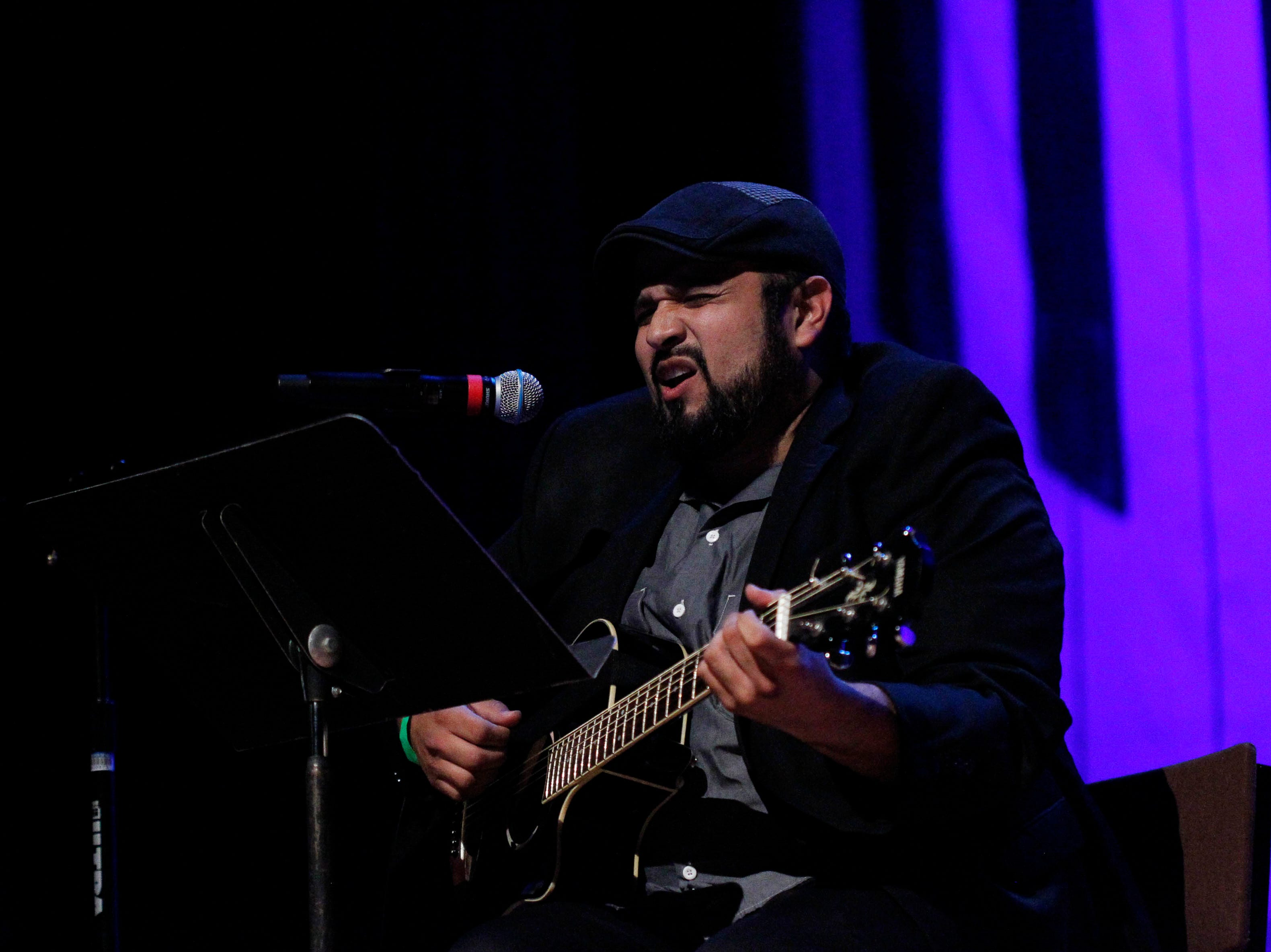 Sergio J. Ramos sings while playing his guitar during the 12th annual Noche Bohemia at Sherwood Hall on Saturday, April 27, 2019 in Salinas, Calif.