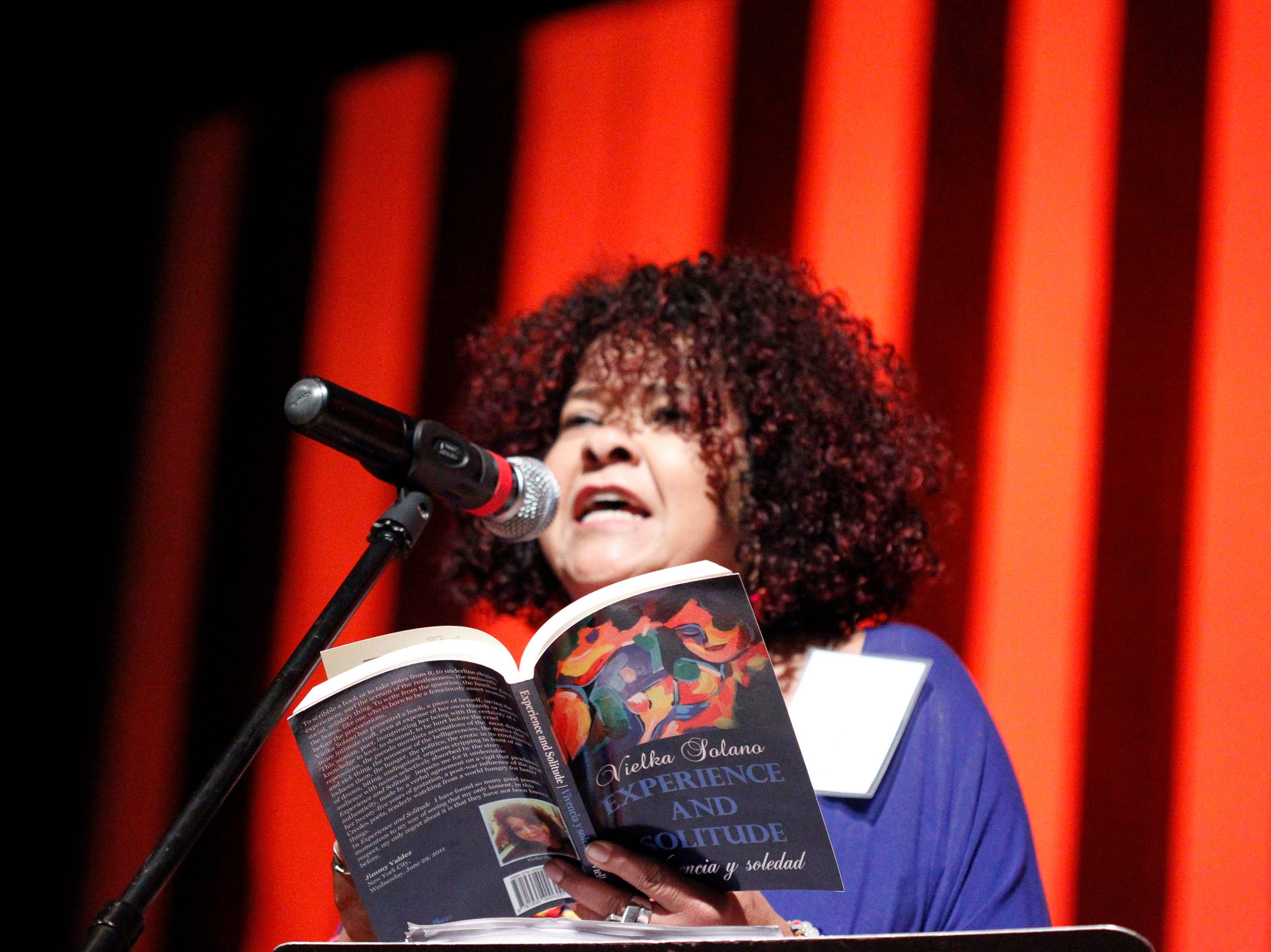 Author Vielka Solano performs a dramatic reading from her book during the12th annual Noche Bohemia at Sherwood Hall on Saturday, April 27, 2019 in Salinas, Calif.