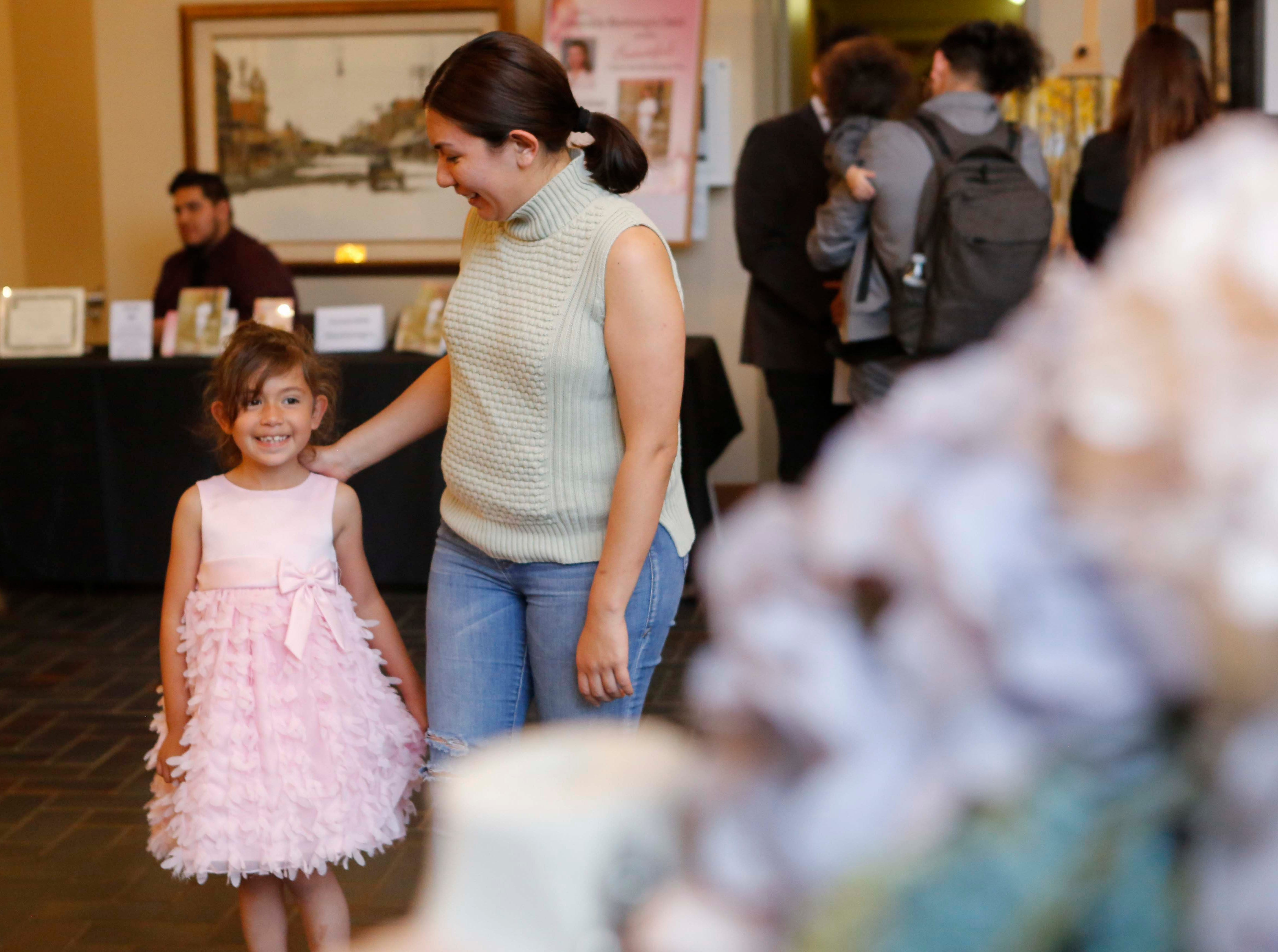 A little girl with her mom gets excited as they approach a bridal booth during the 12th annual Noche Bohemia at Sherwood Hall on Saturday, April 27, 2019 in Salinas, Calif.