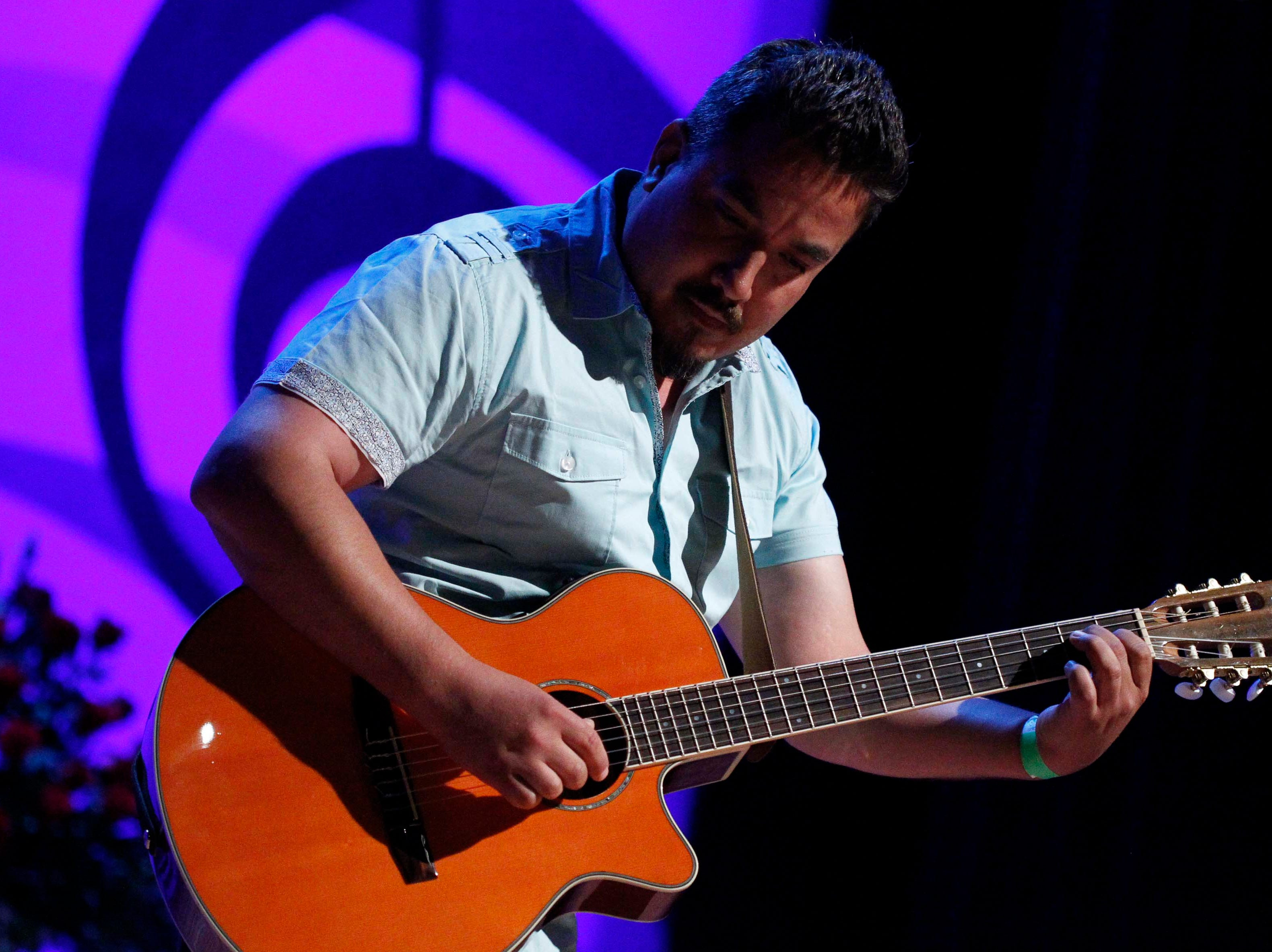 Jesús Brian Messina Sánchez plays his guitar during the12th annual Noche Bohemia at Sherwood Hall on Saturday, April 27, 2019 in Salinas, Calif.