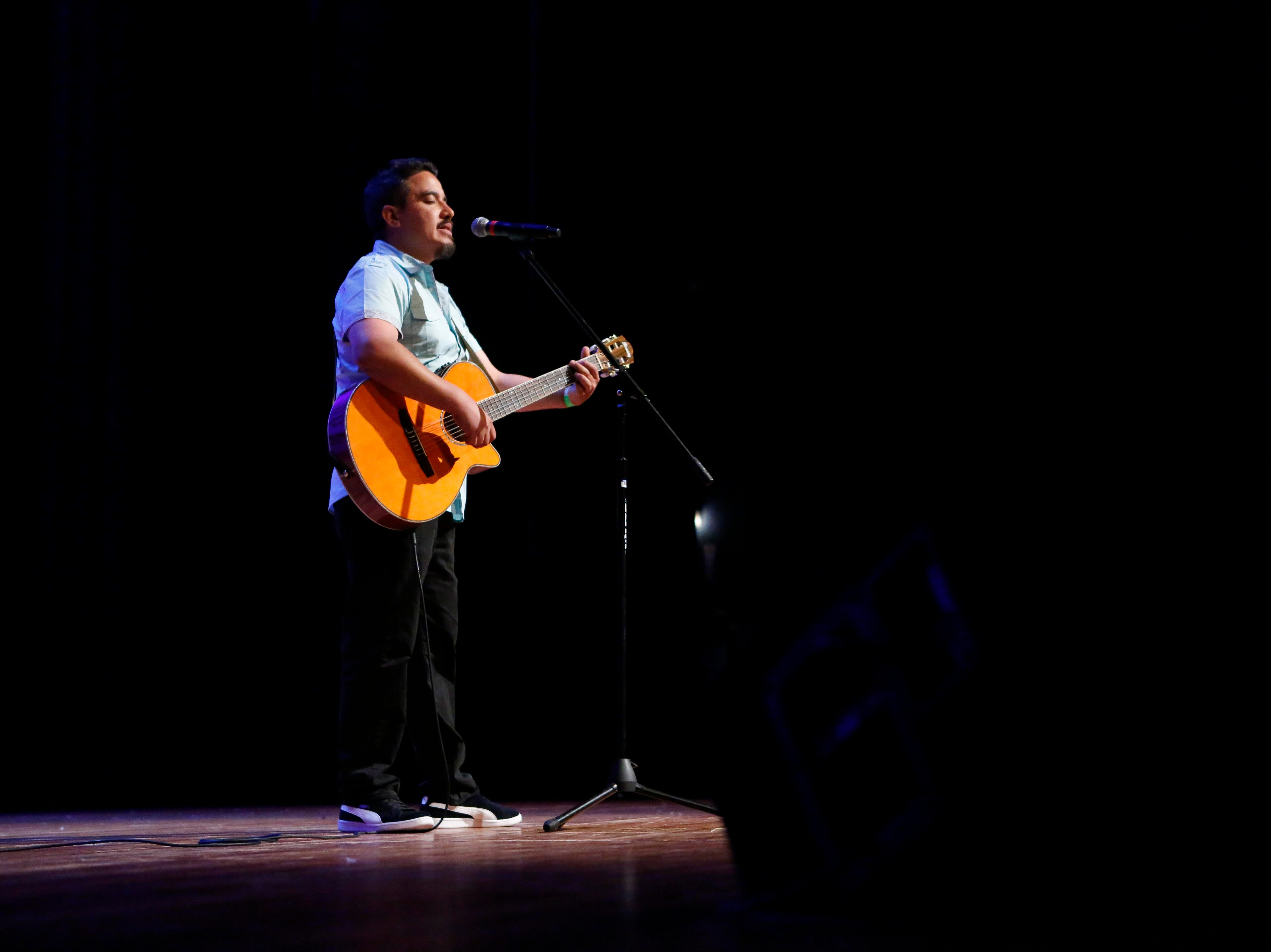 Jesús Brian Messina Sánchez sings as he plays his guitar during the12th annual Noche Bohemia at Sherwood Hall on Saturday, April 27, 2019 in Salinas, Calif.