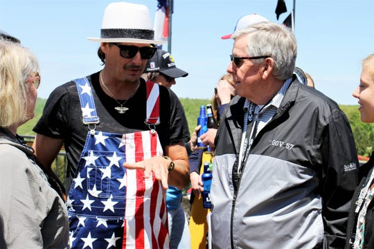 Kid Rock speaks with Missouri Gov. Mike Parson after the second Celebrity Shootout during Bass Pros Legends of Golf Sunday, April 28, 2019.