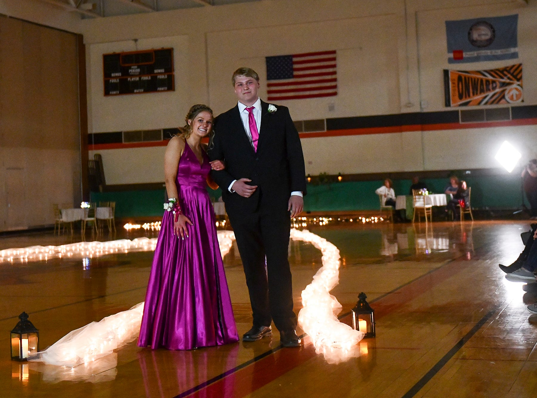 A couple pauses for photos at the end of prom grand march Saturday, April 27, at Tech High School in St. Cloud.
