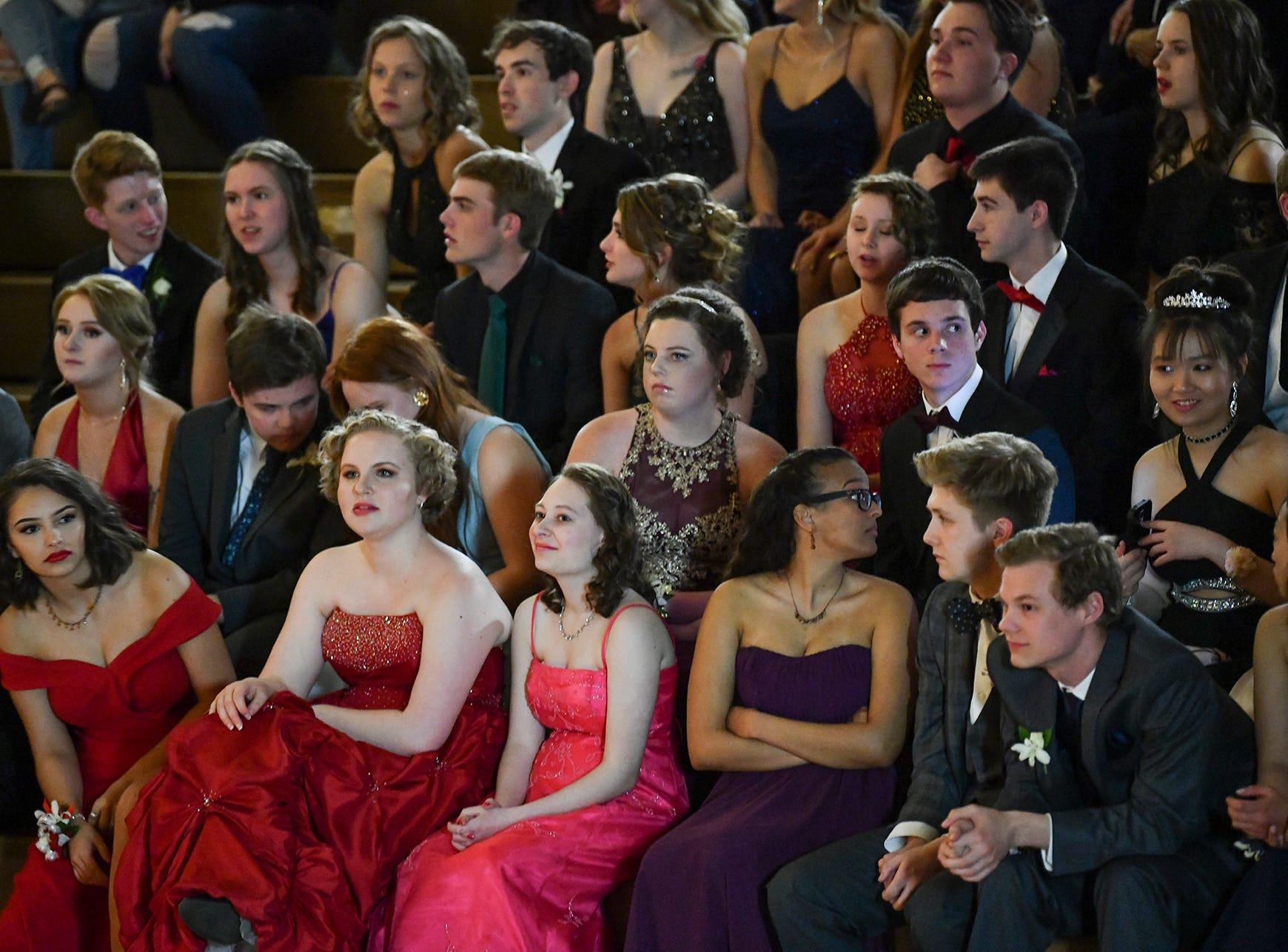 Students watch their classmates during prom grand march Saturday, April 27, at Tech High School in St. Cloud.