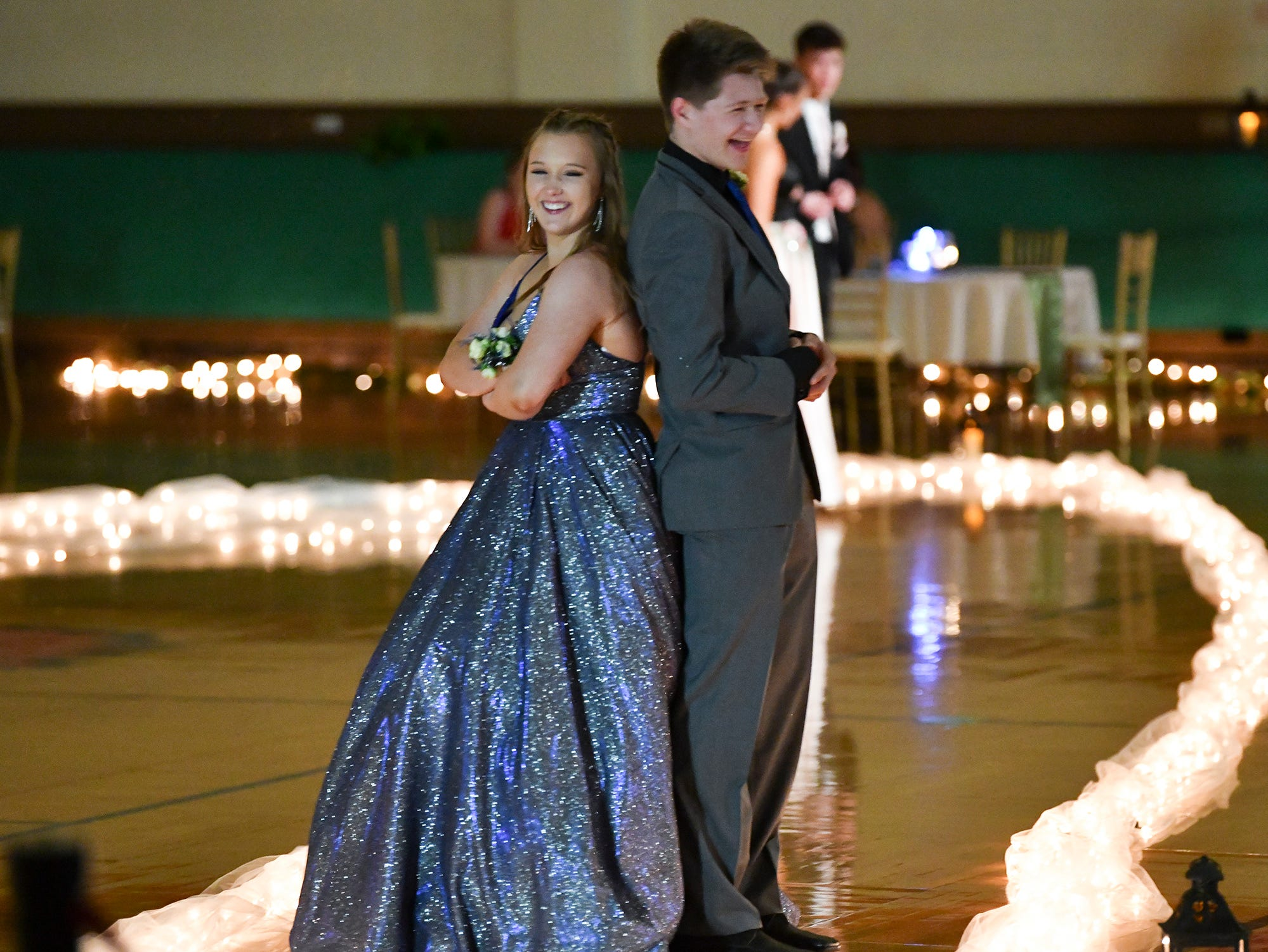 Couples strike a pose during prom grand march Saturday, April 27, at Tech High School in St. Cloud.
