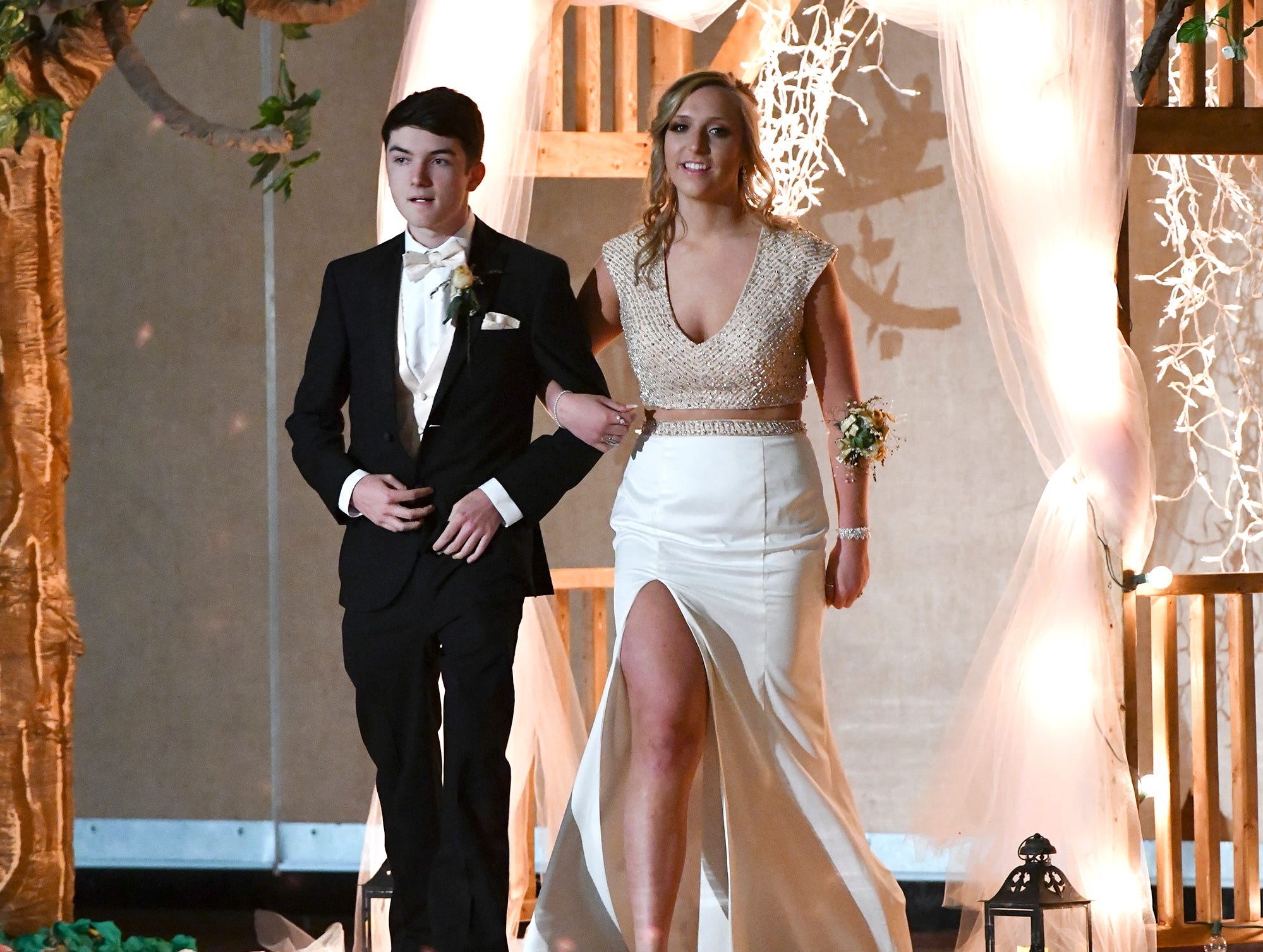 Couples take part in prom grand march Saturday, April 27, at Tech High School in St. Cloud.