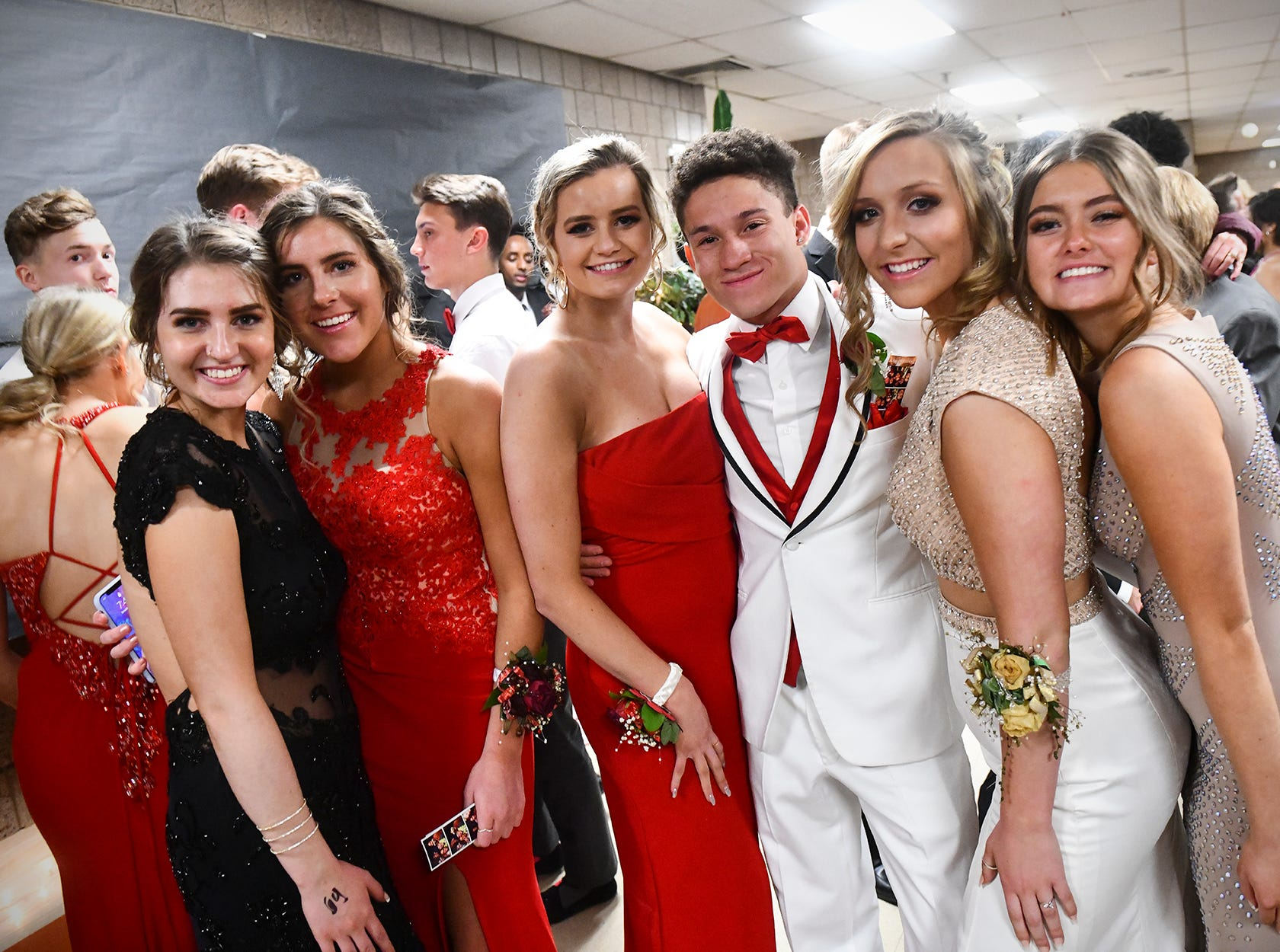 Friends gather for a photograph following prom grand march Saturday, April 27, at Tech High School in St. Cloud.