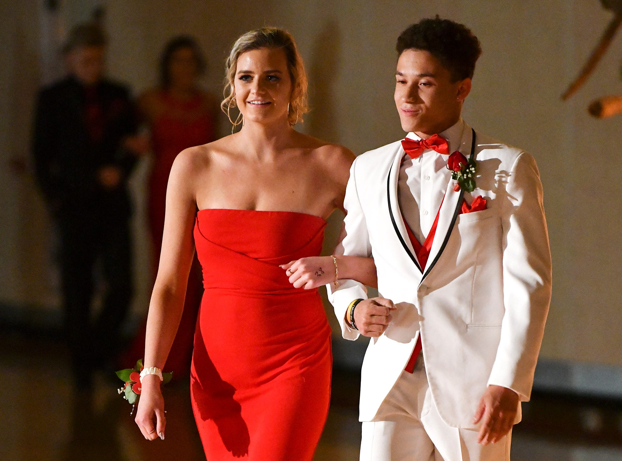 Couples take their turn at prom grand march Saturday, April 27, at Tech High School in St. Cloud.