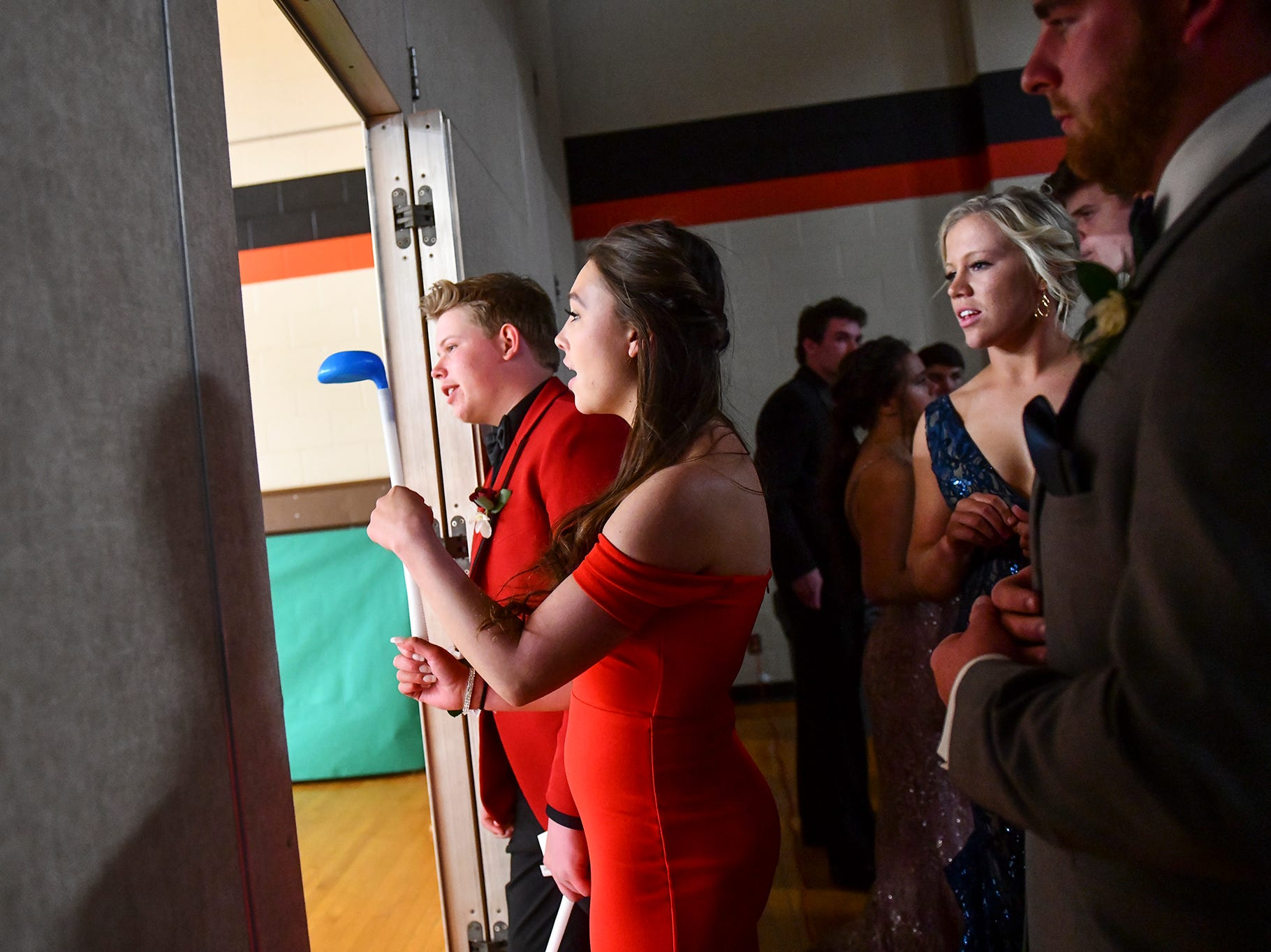 Students get ready for their turn at prom grand march Saturday, April 27, at Tech High School in St. Cloud.