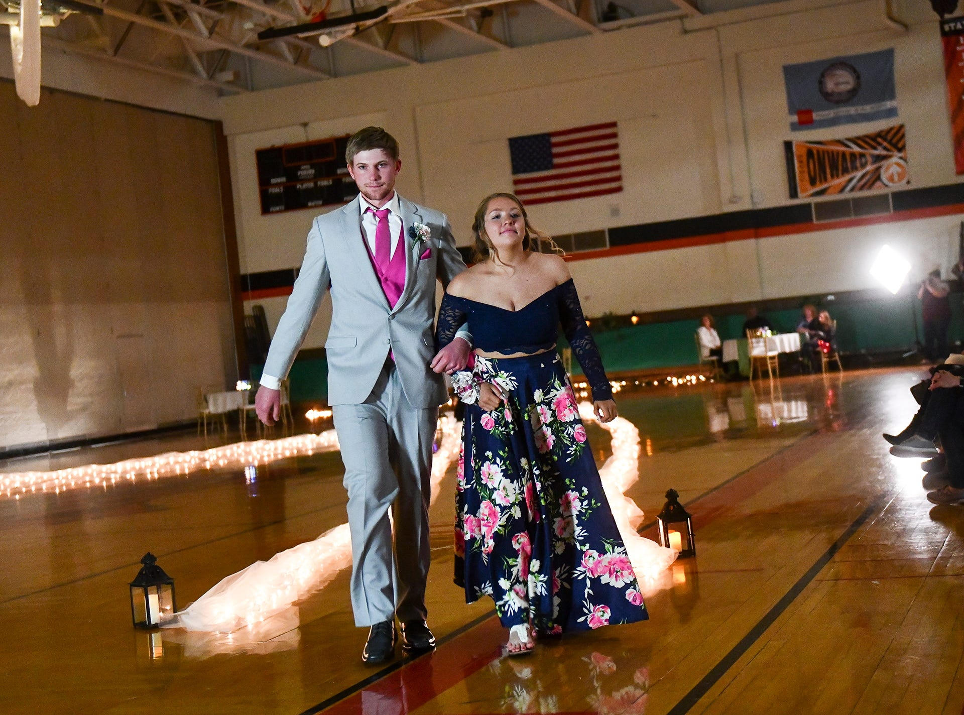 Students complete their turn at prom grand march Saturday, April 27, at Tech High School in St. Cloud.