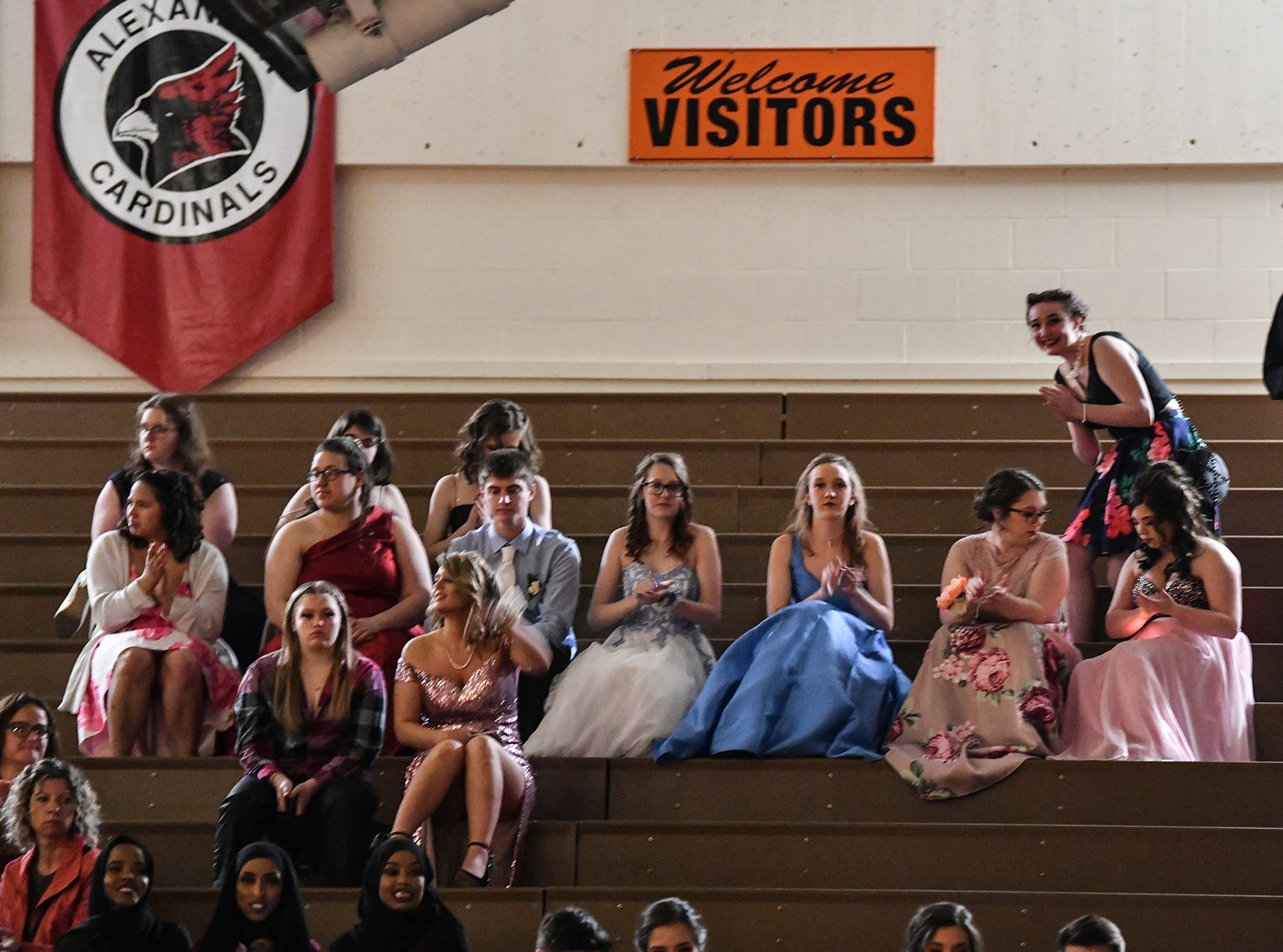 Students watch following their turns at prom grand march Saturday, April 27, at Tech High School in St. Cloud.