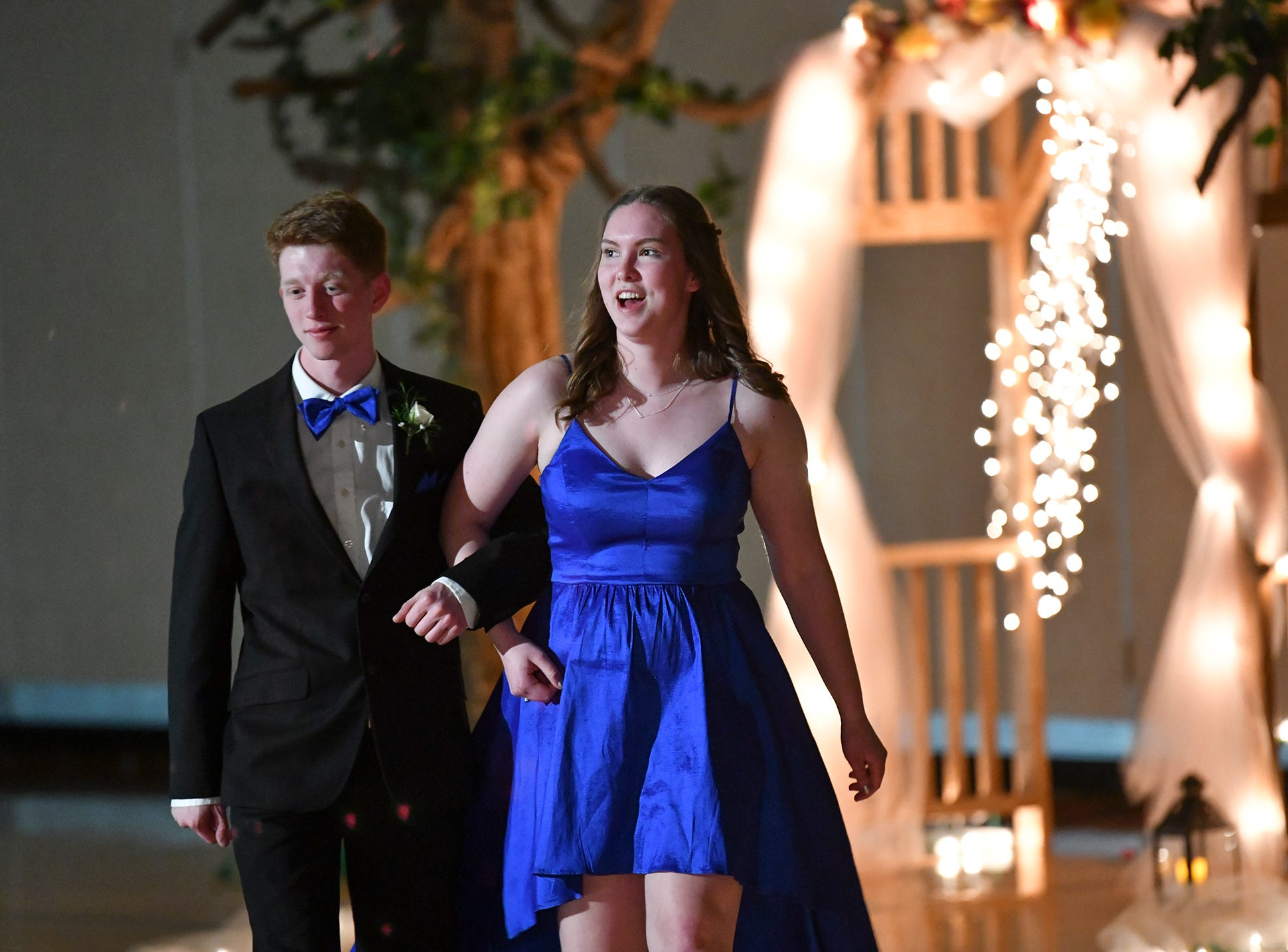 Couples smile during prom grand march Saturday, April 27, at Tech High School in St. Cloud.