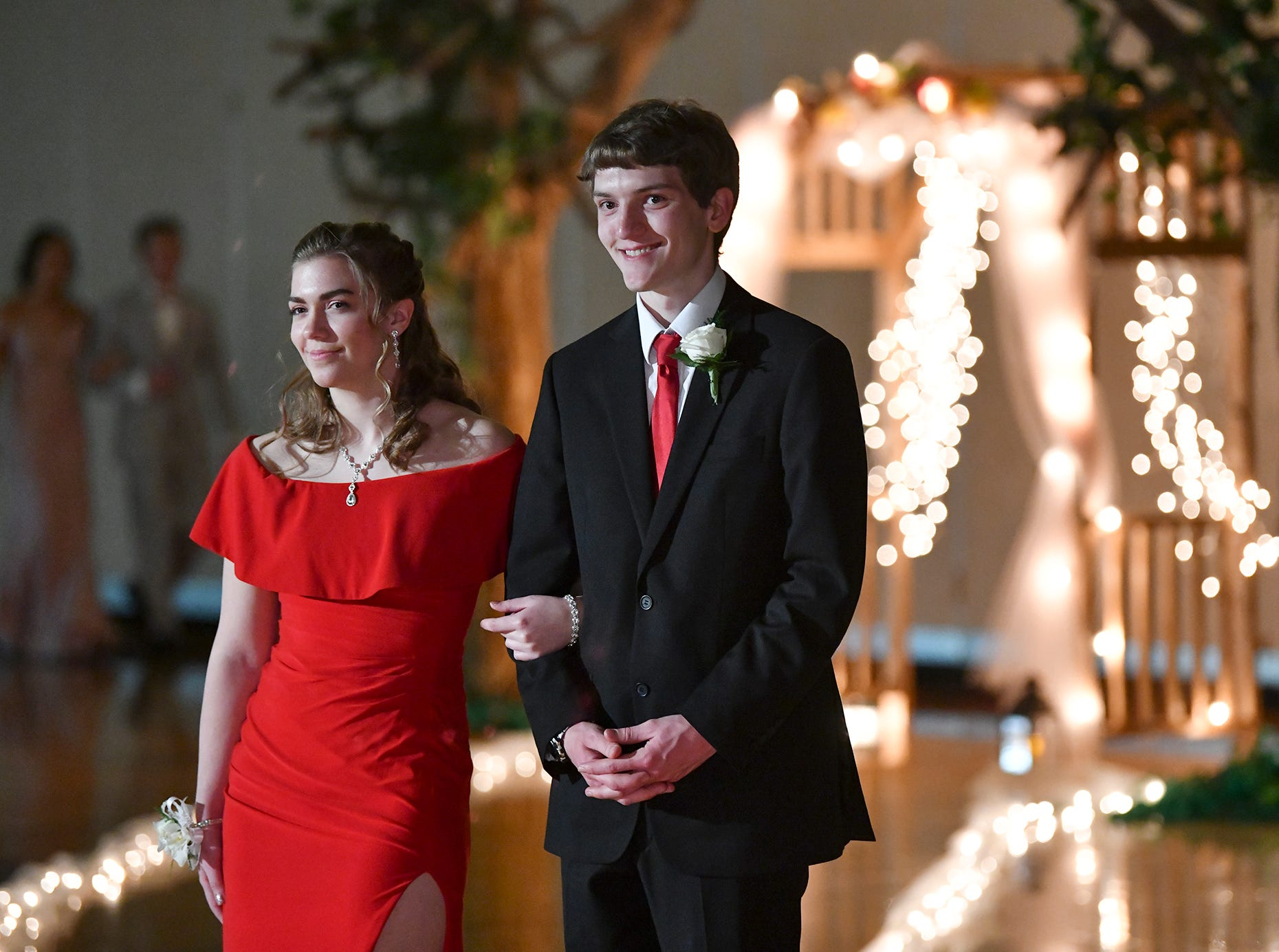 A couple smiles during their turn at prom grand march Saturday, April 27, at Tech High School in St. Cloud.