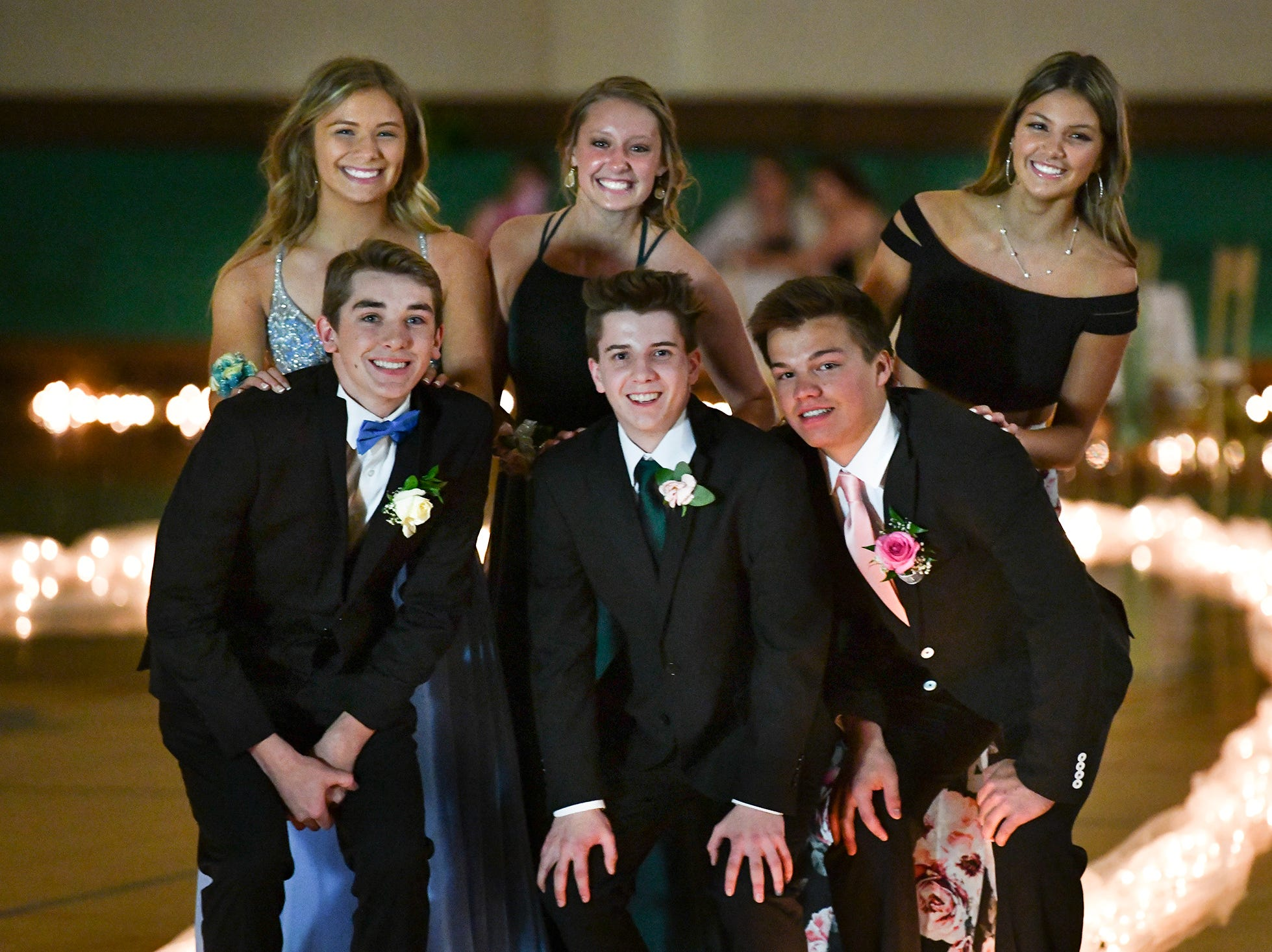 Friends gather for a photo after taking their turn at prom grand march Saturday, April 27, at Tech High School in St. Cloud.