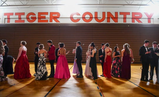 Tech students line up for their turn at  prom grand march Saturday, April 27, at Tech High School in St. Cloud. Saturday's prom was the last to be held in the current Tech gymnasium.