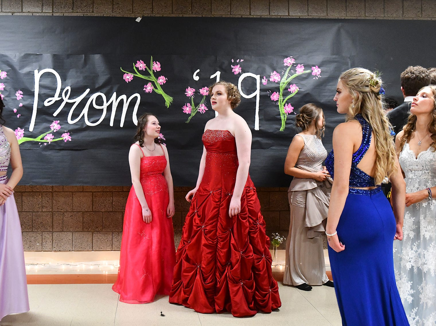 Students gather in the hallway following prom grand march Saturday, April 27, at Tech High School in St. Cloud.