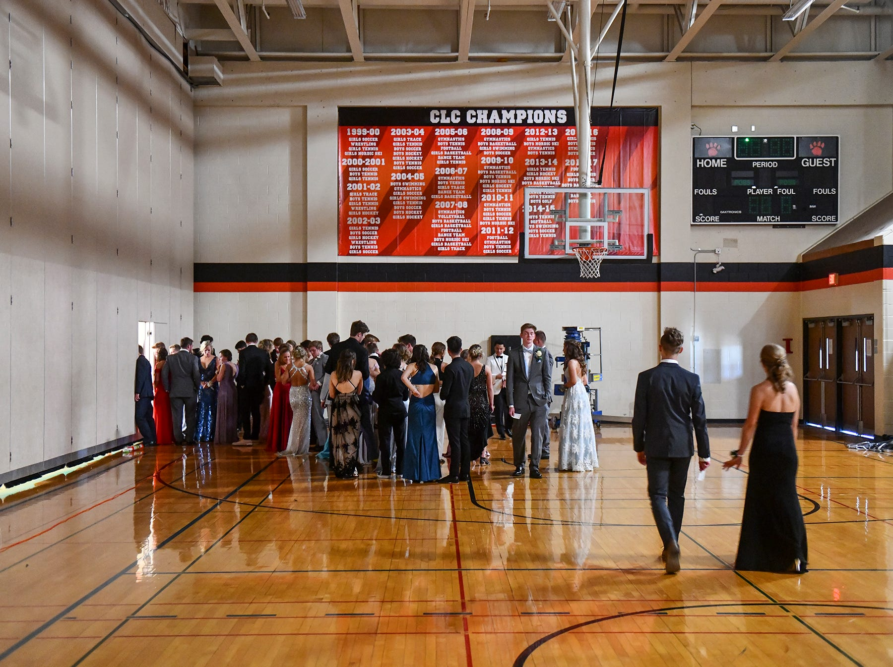 Couples gather in the Tech gymnasium for their turns at prom grand march Saturday, April 27, at Tech High School in St. Cloud.