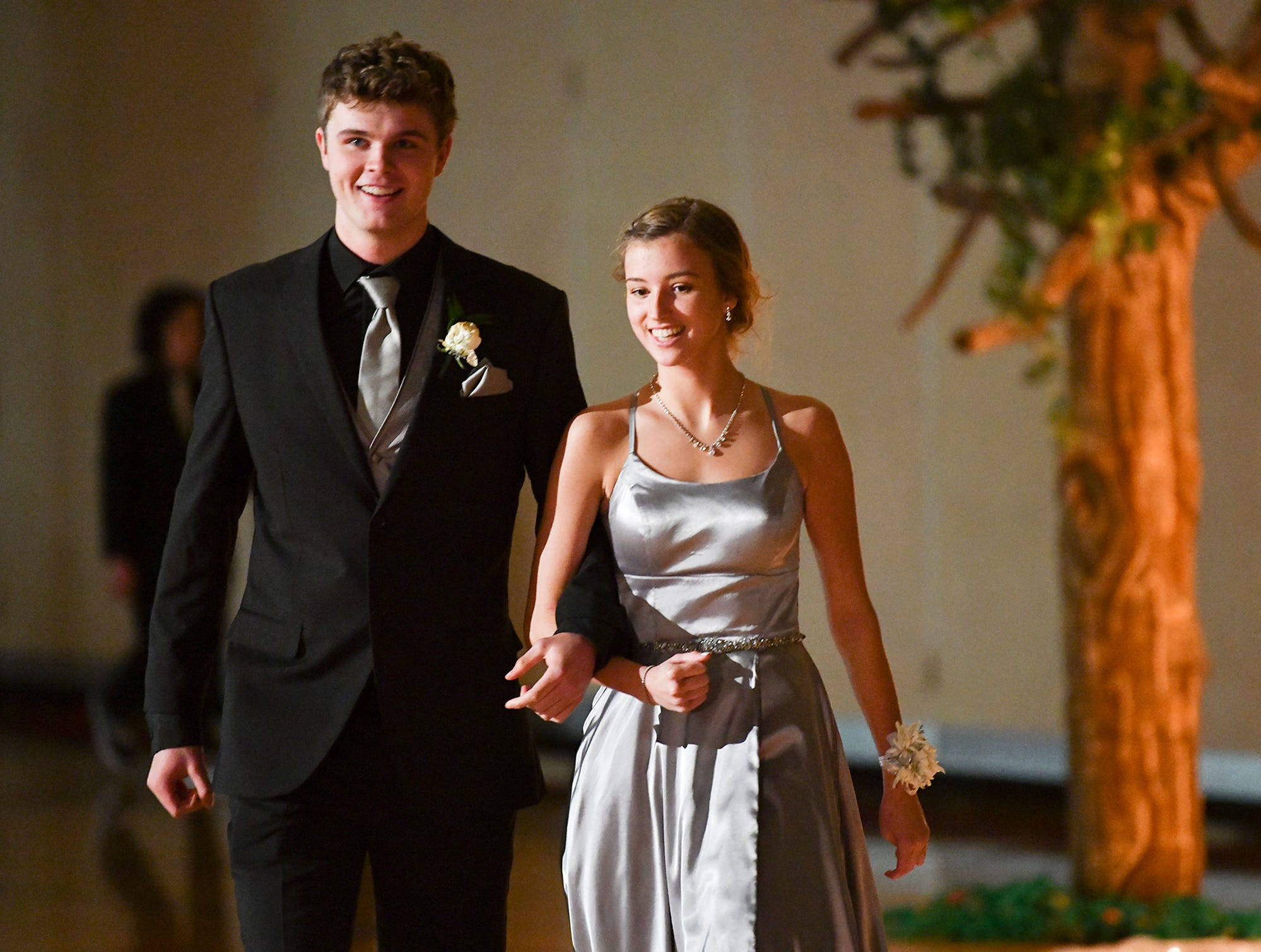 A couple smiles during prom grand march Saturday, April 27, at Tech High School in St. Cloud.