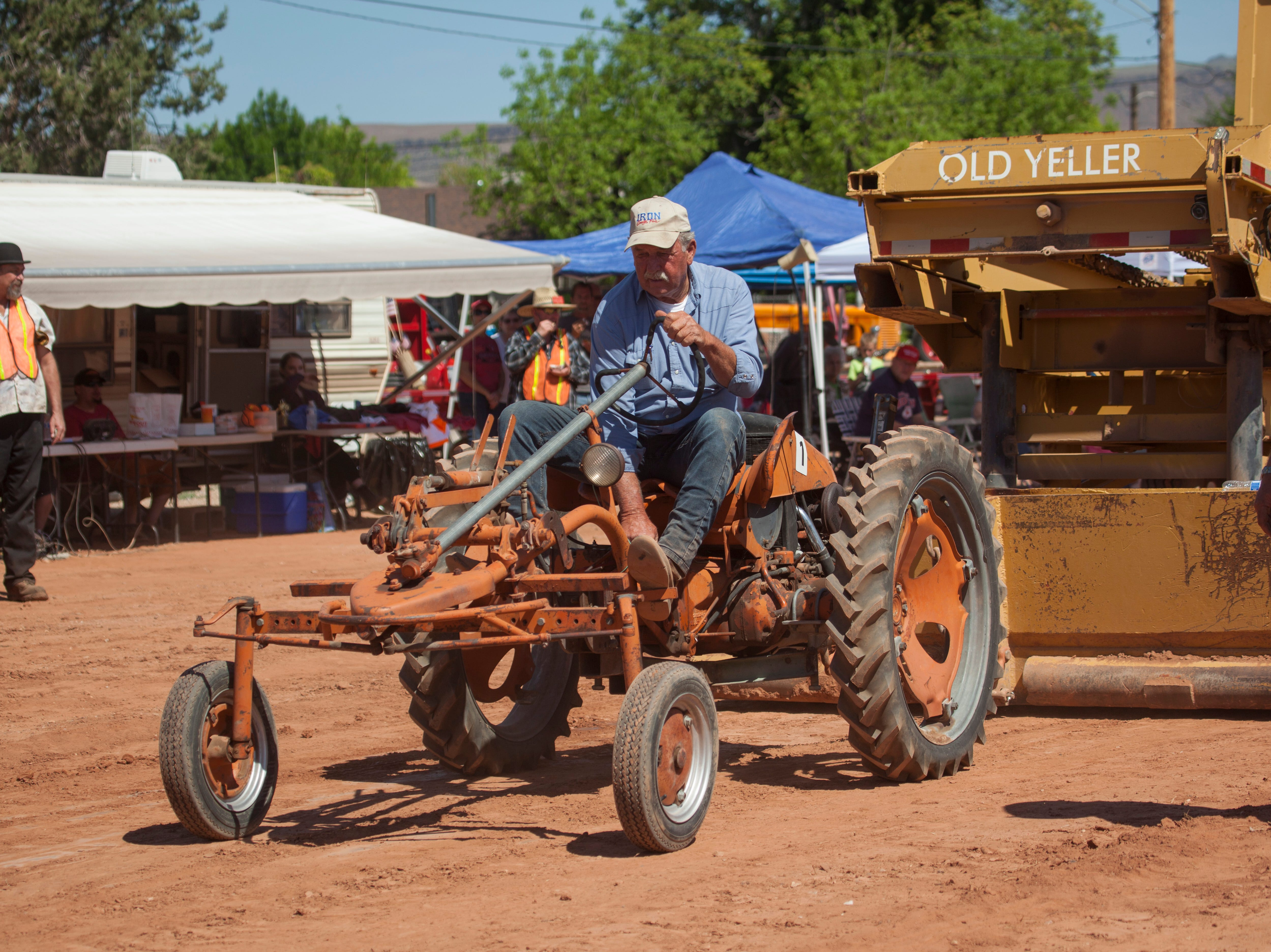 Drivers compete in the Cotton Days tractor pull Saturday, April 27, 2019.