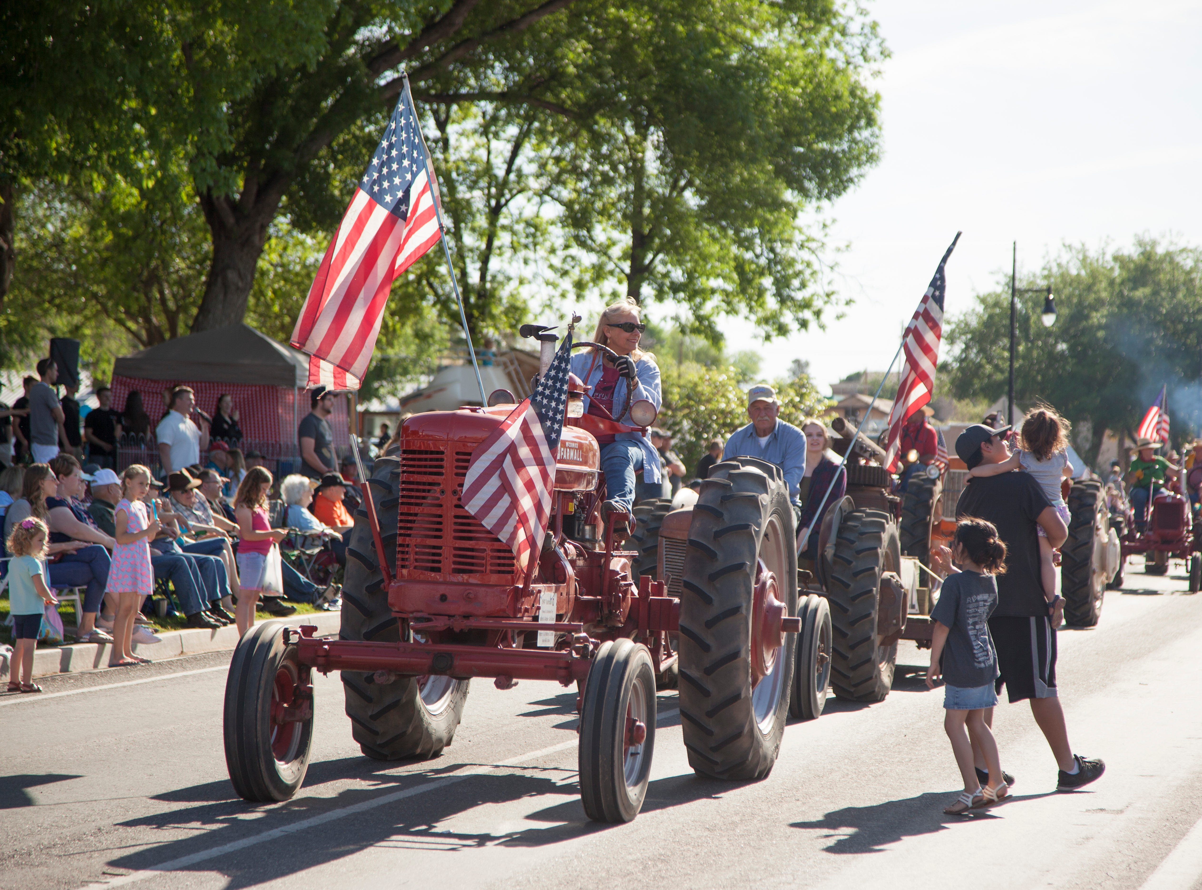Residents gather on Telegraph Street for the annual Cotton Days parade and activities Saturday, April 27, 2019.