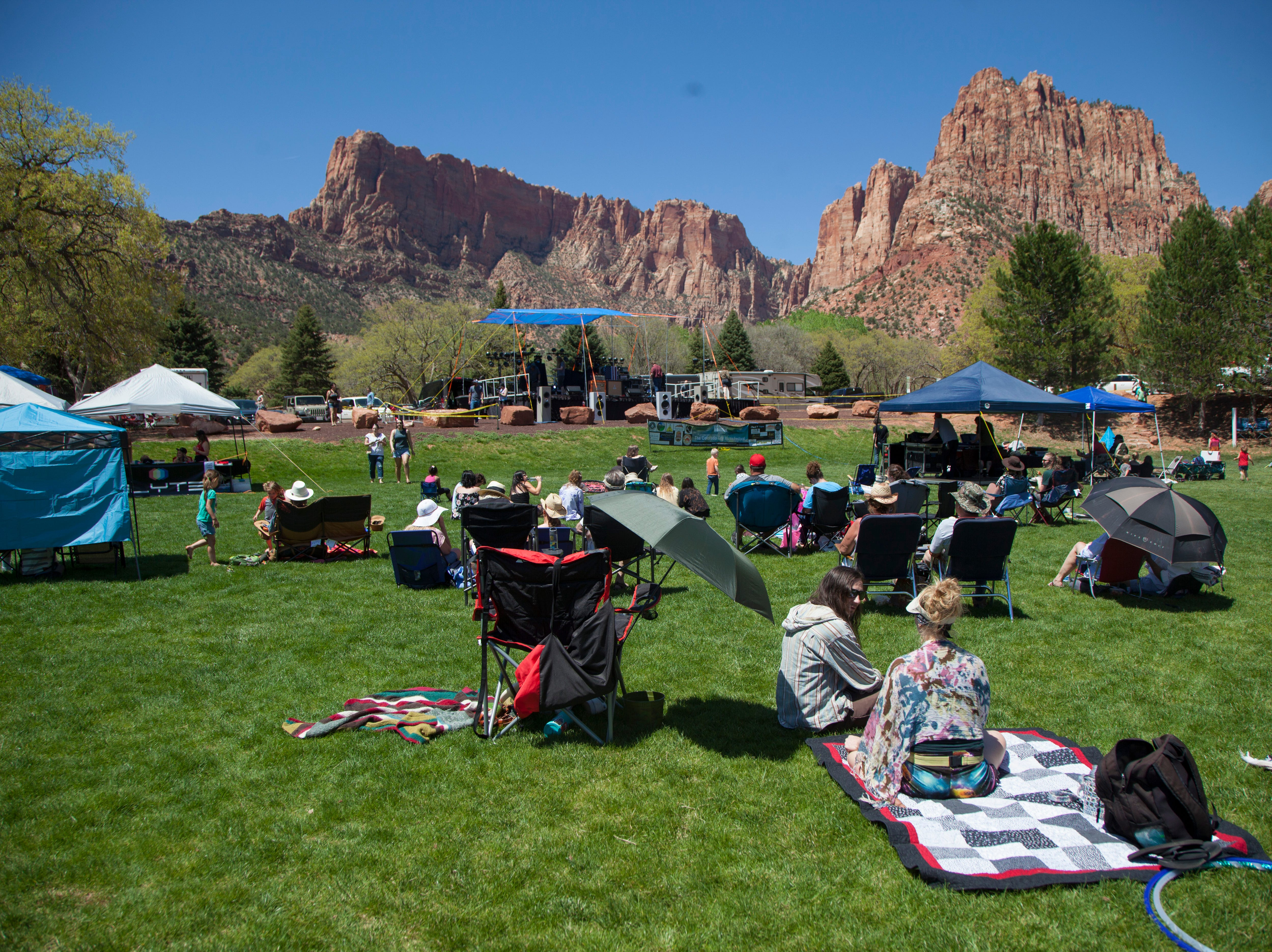 Music fans gather for the third annual Colorado City Music Festival at Maxwell Park in Hildale, Saturday, April 27, 2019.