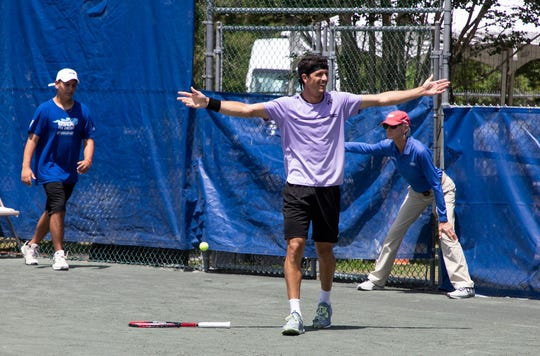 Emilio Gomez reacts to winning the Tallahassee Tennis Challenger at the Forestmeadows Tennis Complex.