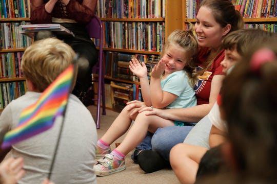 Theodora Cosentino, 3, claps after a queen finishes reading a book during Drag Queen Story Hour at My Favorite Books Sunday, April 28, 2019.