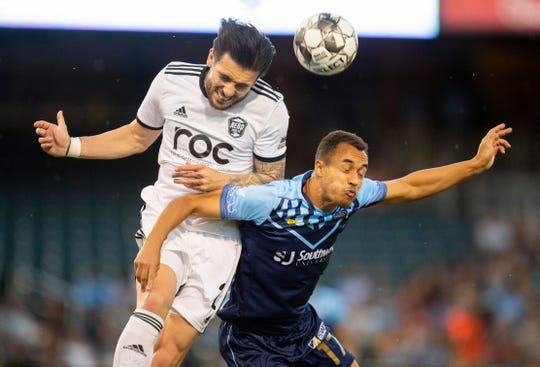 El Paso's Logan Kieswetter (right) vies for a header against Reno's Emrah Klimenta Saturday night at Southwest University Park. The Locomotive won 1-0