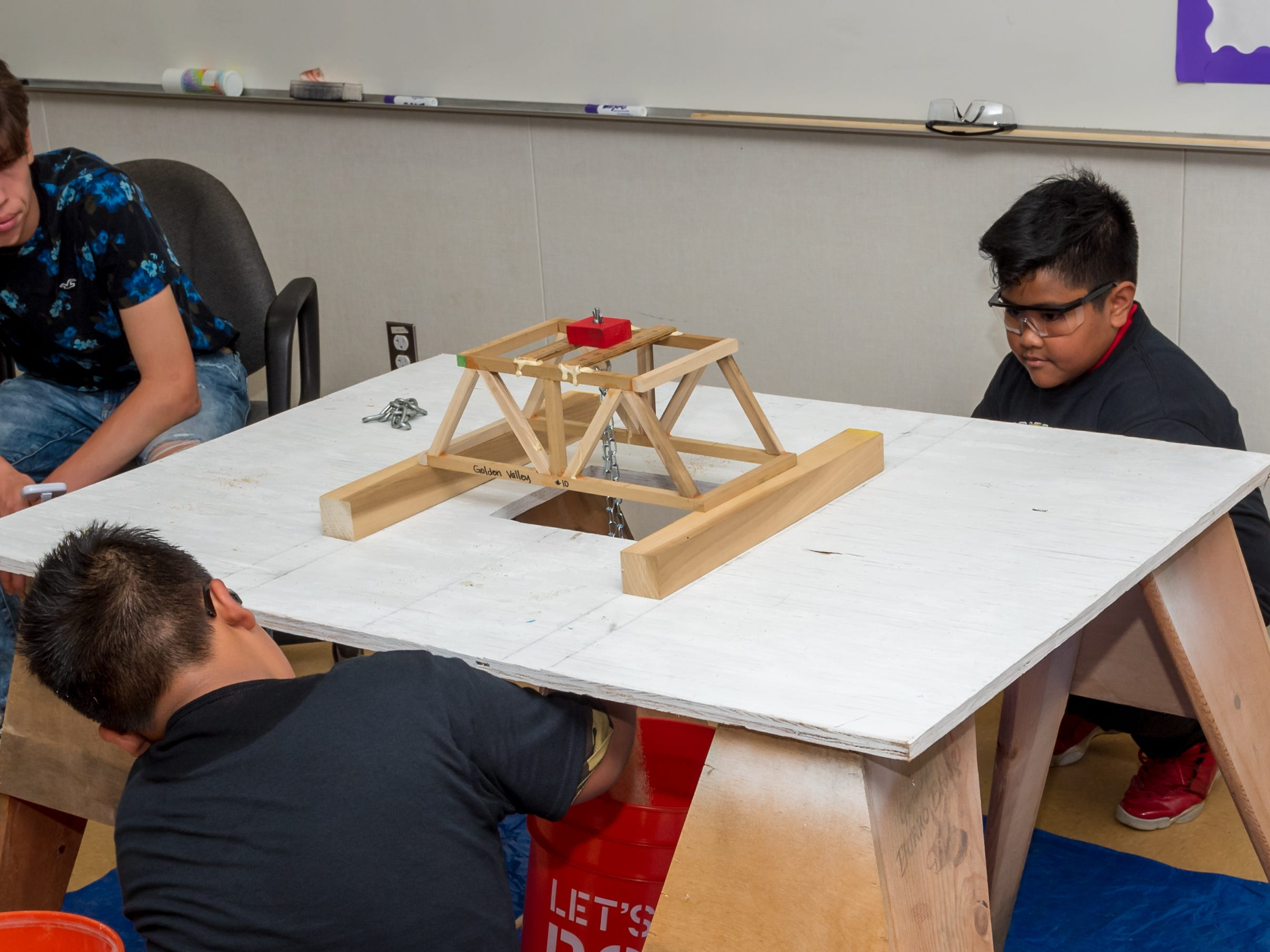 Isiah Calaustro and Renato Carlos compete in the Bridge Building event at the Science Olympiad held at Mission Oak High School in Tulare, Saturday, April. 27, 2019.
