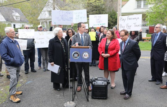 People rally outside of the Trump National Golf Club Westchester in Briarcliff Manor, with New York Sen. David Carlucci, center, and Assemblywoman Sandra Galef, left, April 28, 2019, in support of legislation to change how golf courses are assessed. Also pictured is Westchester County Legislator Catherine Borgia and Assemblyman Thomas Abinanti.