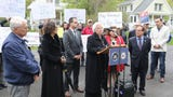New York Sen. David Carlucci and Assemblywoman Sandy Galef hold a rally April 28, 2019 in support of legislation to change how golf courses are assessed.