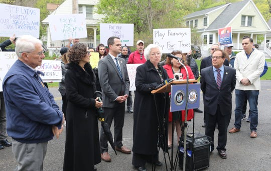 People rally outside of the Trump National Golf Club Westchester in Briarcliff Manor, with Assemblywoman Sandra Galef at podium and New York Sen. David Carlucci, left of Galef, April 28, 2019, in support of legislation to change how golf courses are assessed. Also pictured is Westchester County Legislator Catherine Borgia, right and Assemblyman Thomas Abinanti.