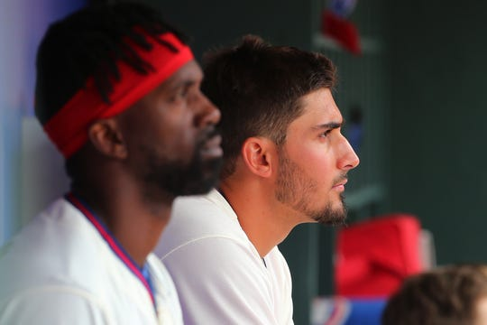 PHILADELPHIA, PA - APRIL 28: Pitcher Zach Eflin #56 and Andrew McCutchen #22 of the Philadelphia Phillies watch from the dugout during the eighth inning of a game against the Miami Marlins at Citizens Bank Park on April 28, 2019 in Philadelphia, Pennsylvania. Eflin pitched a complete game as the Phillies defeated the Marlins 5-1.