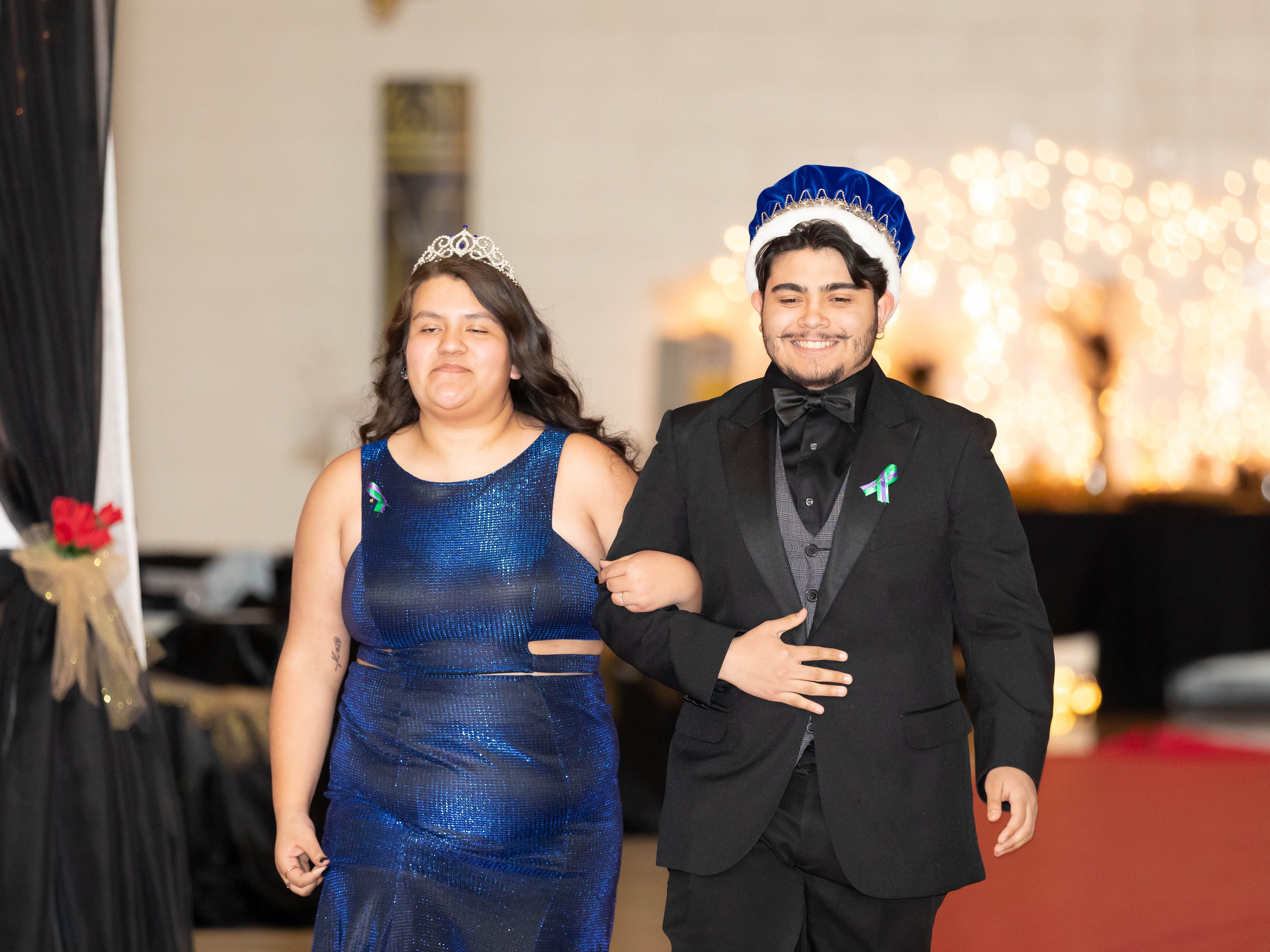 Jazmin Gonzalez and Adrian Rodriguez, the 2018 Nekoosa High School prom queen and king, participate in the grand march on Saturday, April 27, 2019, at Nekoosa High School.