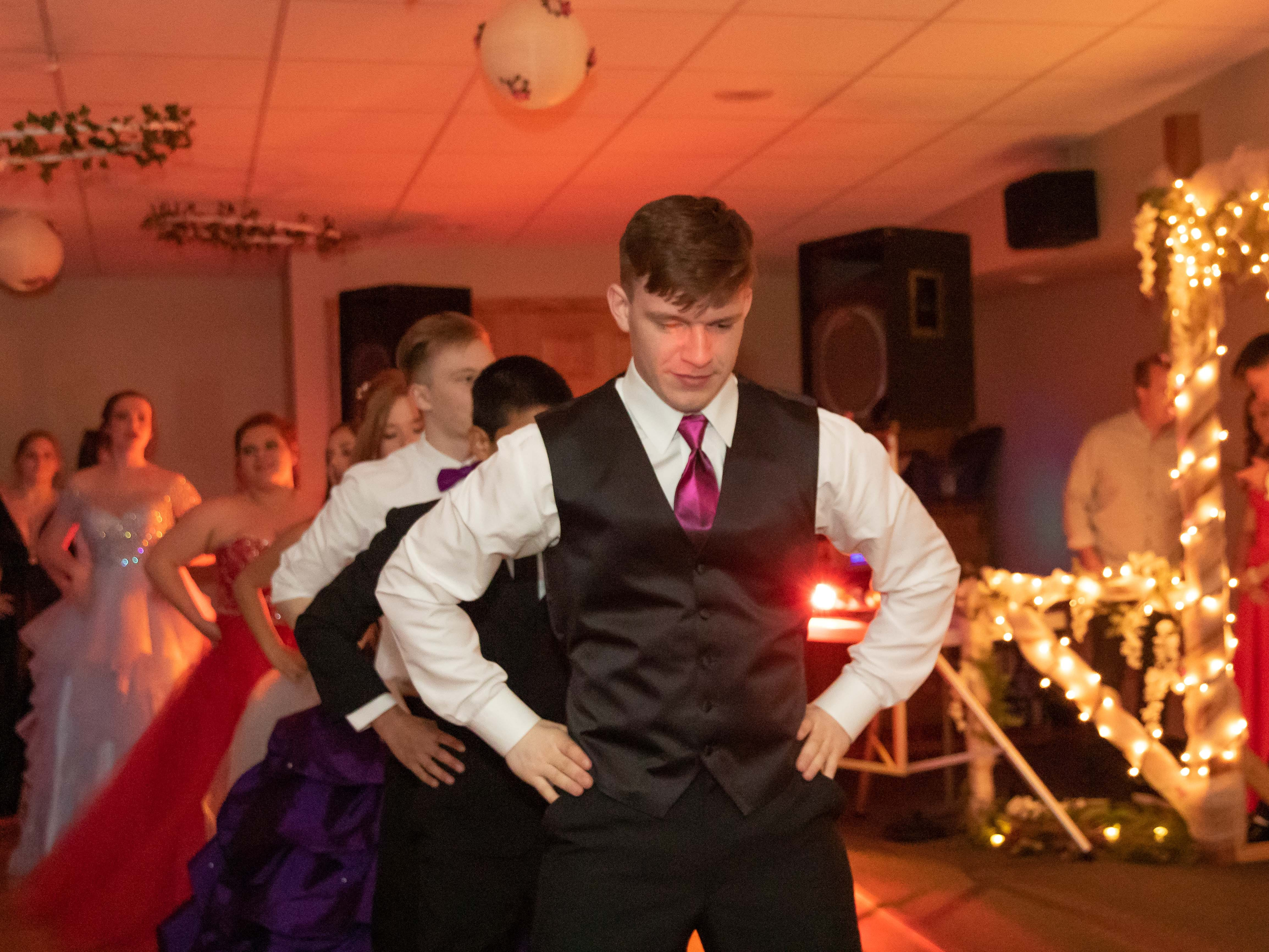Students dance during the John Edwards High School prom Saturday, April 27, 2019, at the Wisconsin Rapids Elks Club.