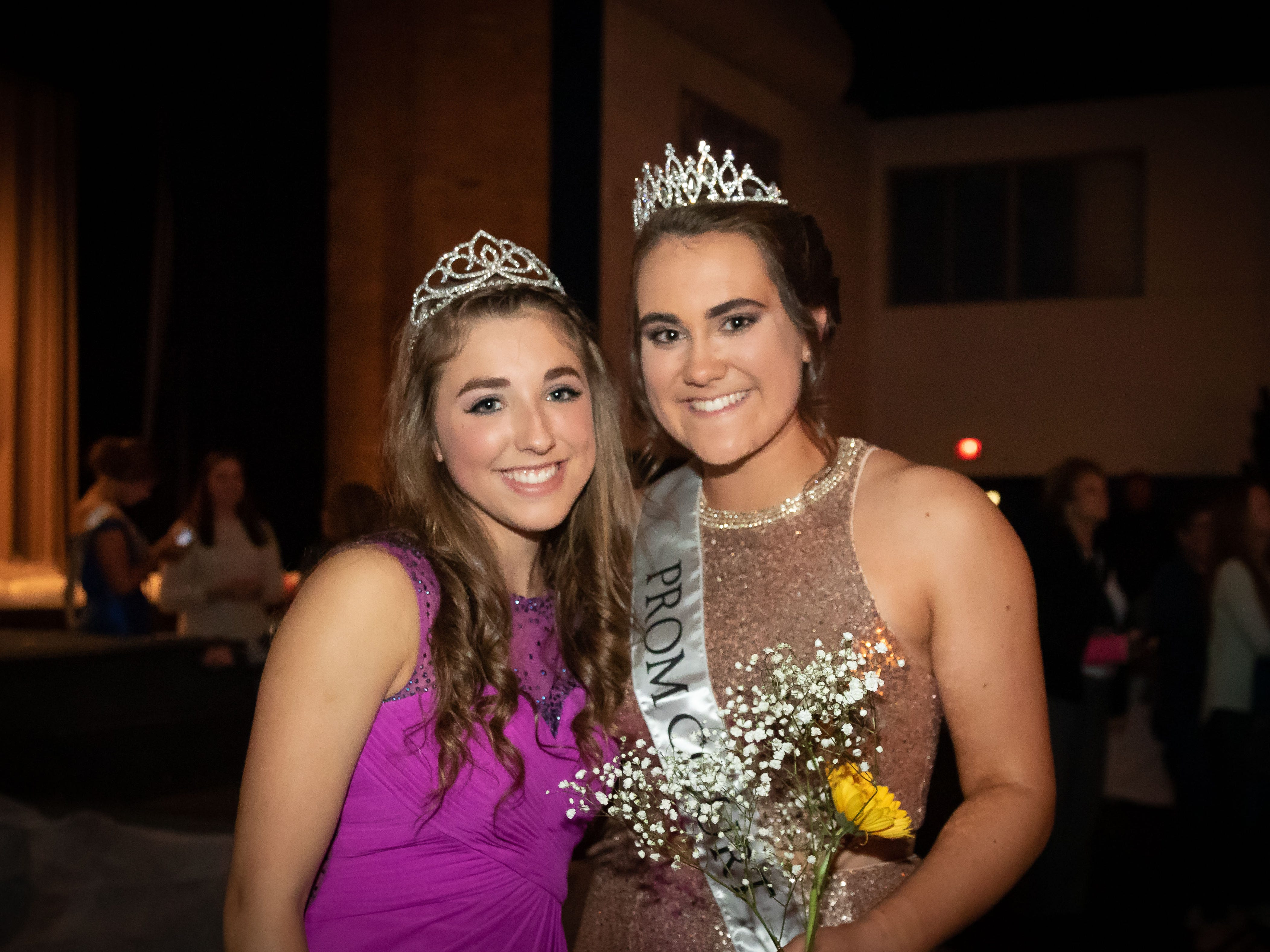 2018 Prom Queen Ellie Shaw and 2019 Prom Queen Calli Statz pose for a photo during the Assumption High School prom on Saturday, April 27, 2019, at the high school in Wisconsin Rapids.
