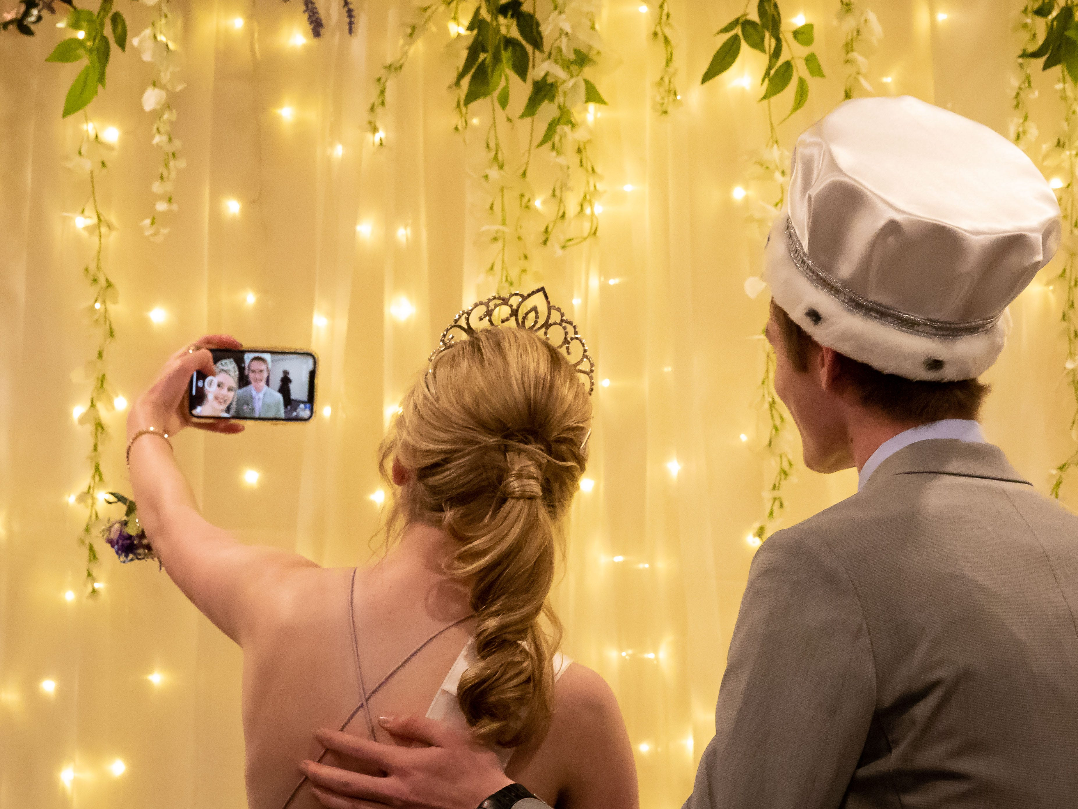 Prom queen Molly McCarthy and king Derek Coates take a selfie during the John Edwards High School prom on Saturday, April 27, 2019, at the Wisconsin Rapids Elks Club.