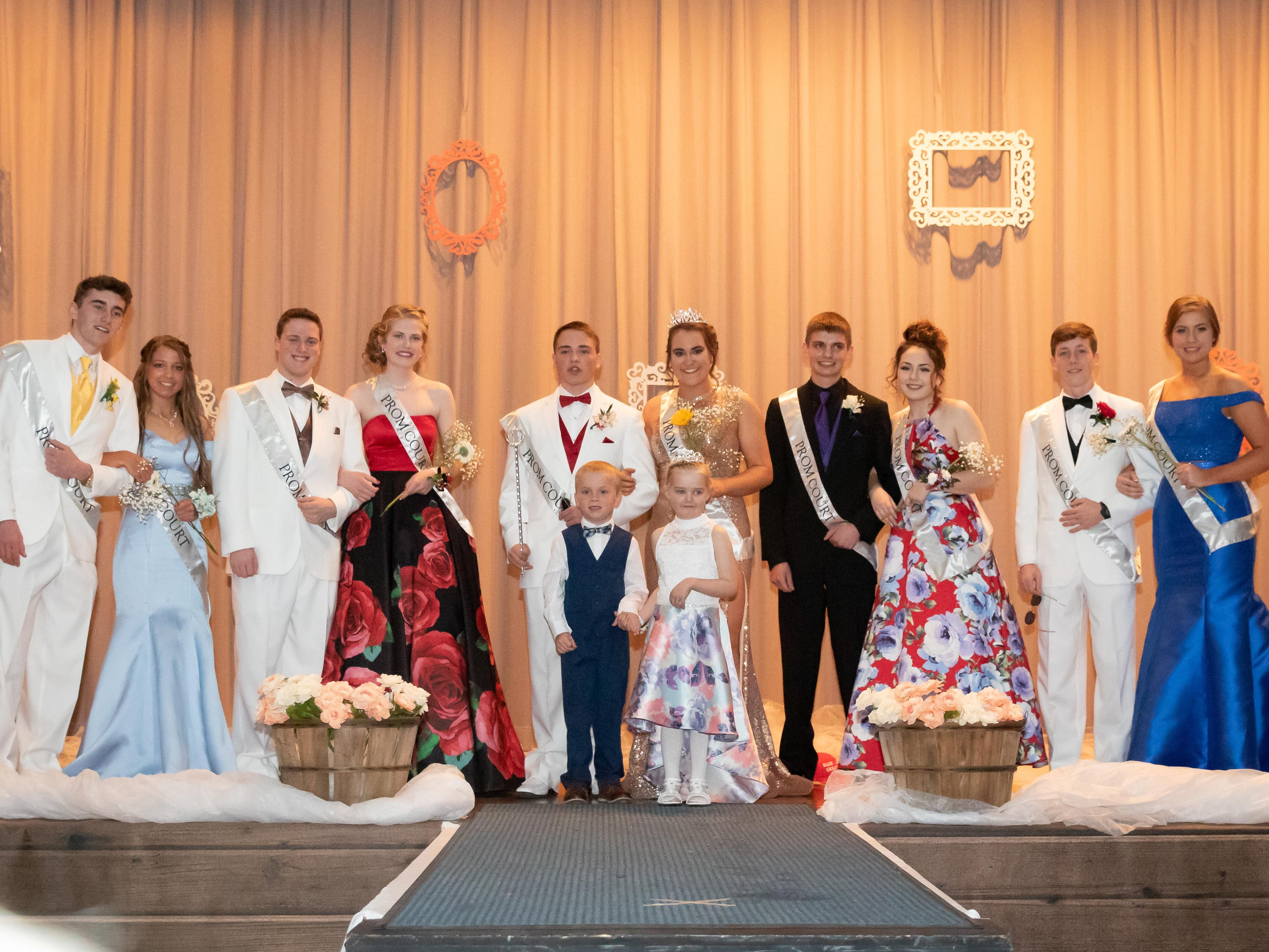 Members of the 2019 Assumption High School prom court are Dennis Matott, Penny Bires, Ryan Hustedt, Paige Donahue, king Jaret Hartley, queen Calli Statz, Dan Esser, Abigail Ashbeck, Garrett Dolan and Maddy Bohn. They are pictured with miniature court members Logan Breu and Lux Lobner during the Assumption High School prom on Saturday, April 27, 2019, at the high school in Wisconsin Rapids.