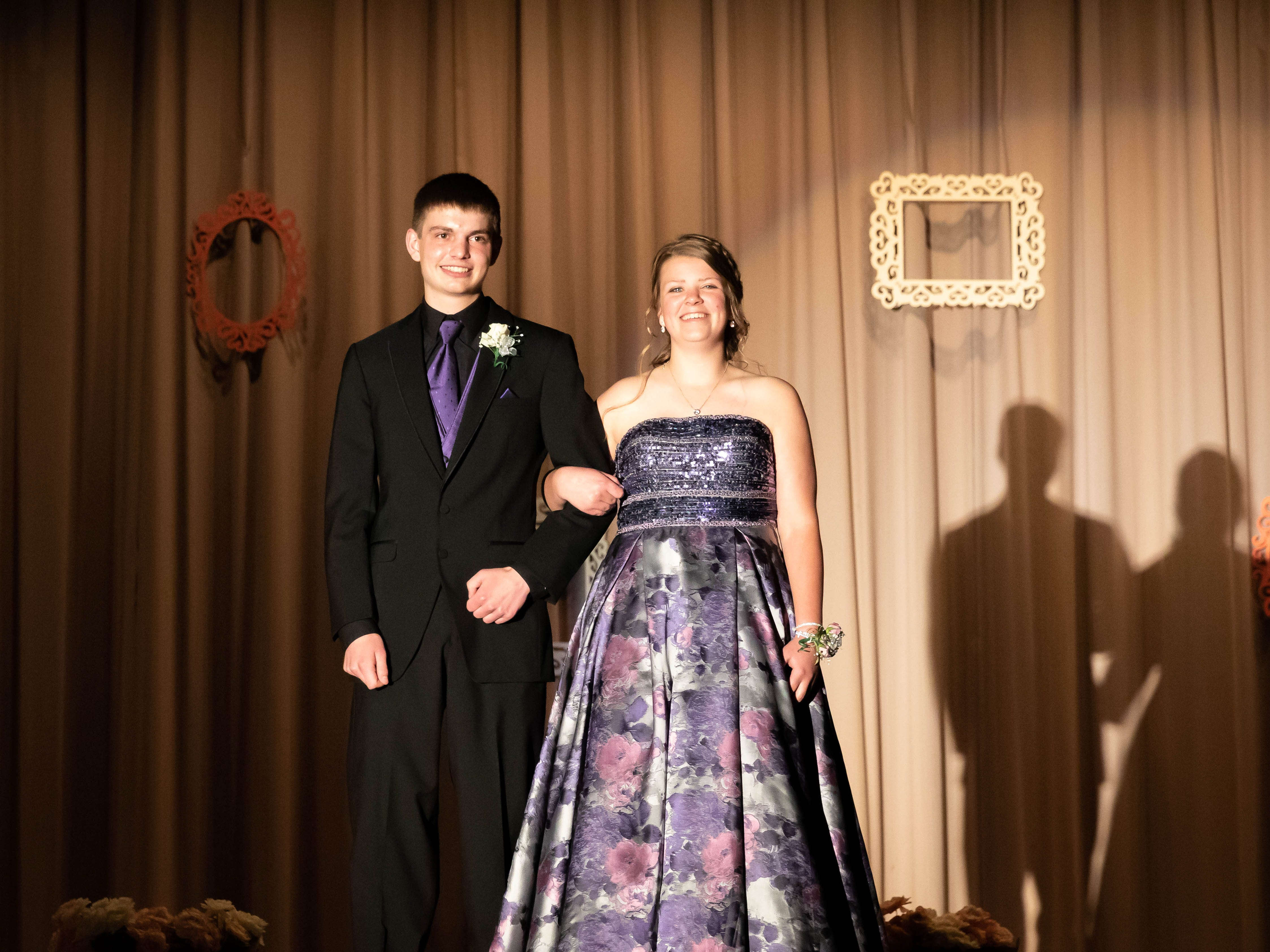 Students participate in the grand march during the Assumption High School prom on Saturday, April 27, 2019, at Assumption High School.