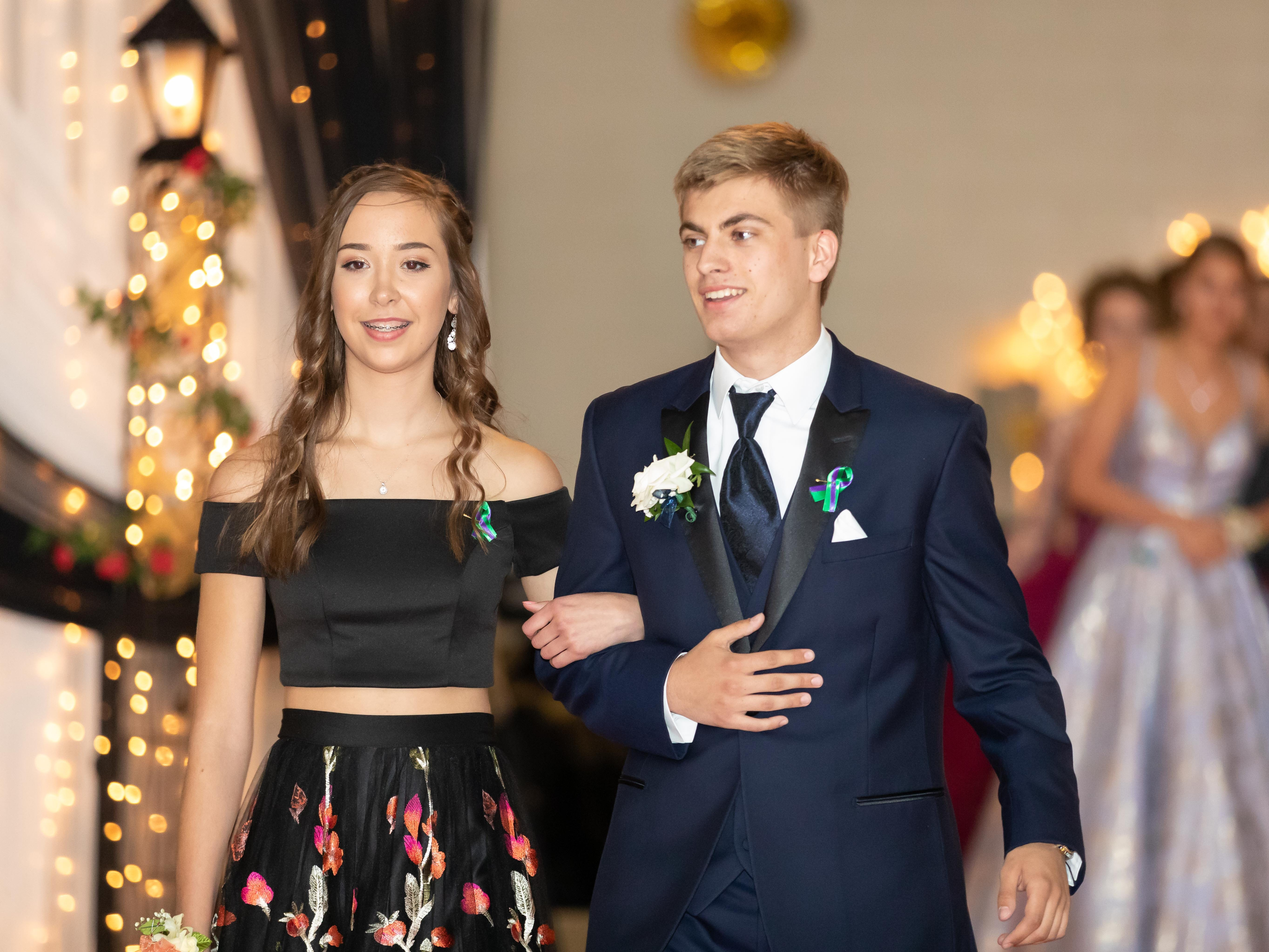 Students participate in the grand march during the Nekoosa High School Prom on Saturday, April 27, 2019, at Nekoosa High School.