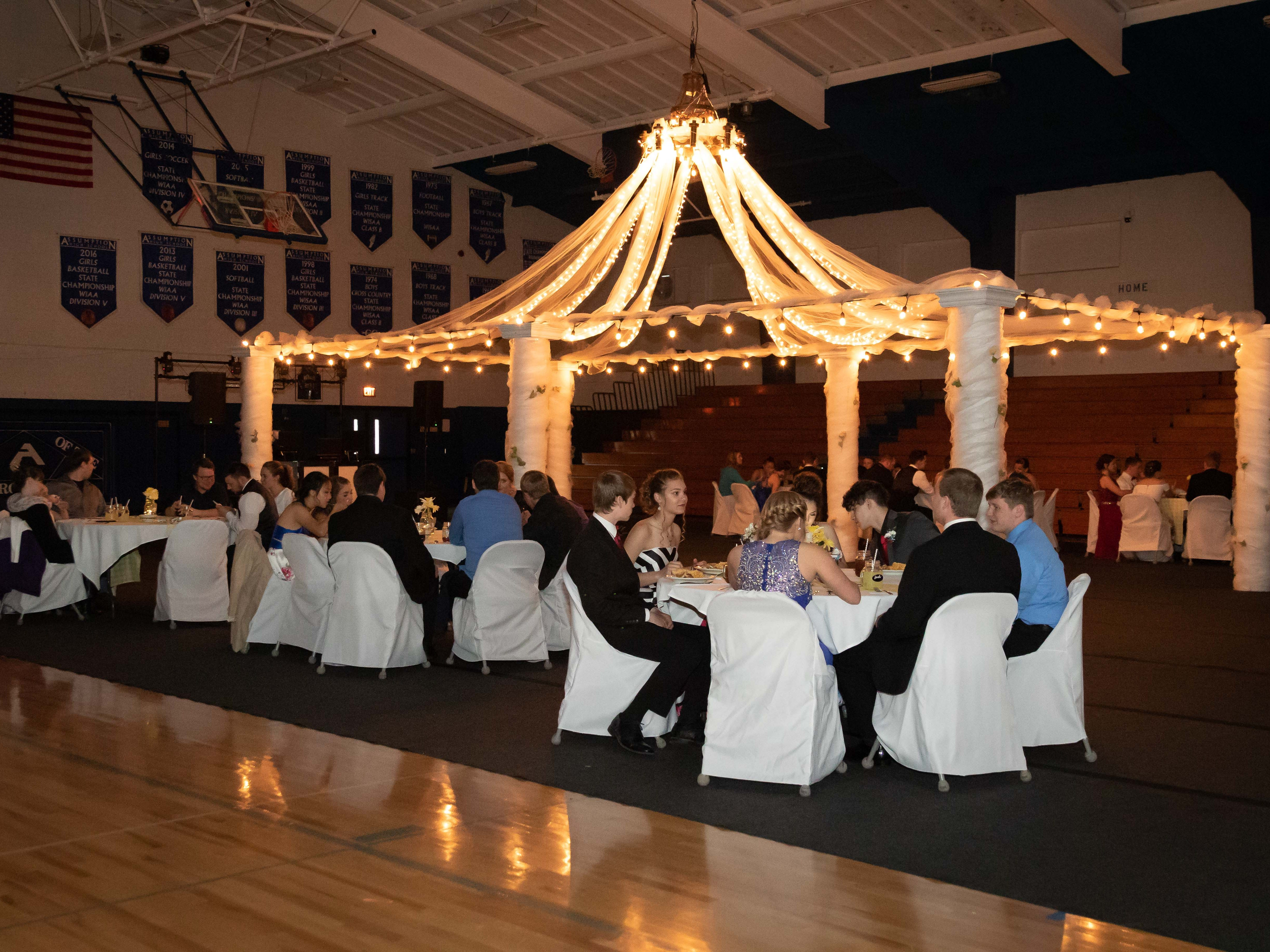 Students enjoy dinner before the Assumption High School prom on Saturday, April 27, 2019, at Assumption High School.