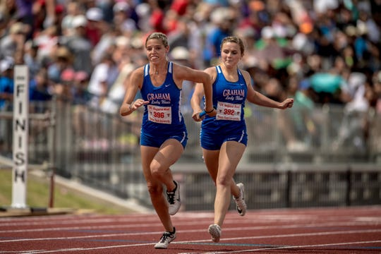 Graham's Claire Jones hands the baton to Rosie Schaffer Saturday in the Region I-4A girls 4x200 relay.