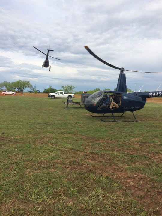 Helicopters leaving with veterans to hunt hogs at the Circle Bar Ranch, an annual event  where wounded warriors can hunt wild hogs and coyotes from helicopters.