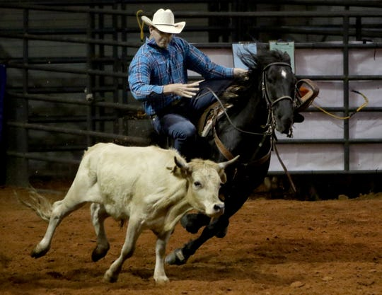 Chance Howard slips off his horse for steer wrestling in the PRCA Rodeo Saturday, April 27, 2019, in Kay Yeager Coliseum.
