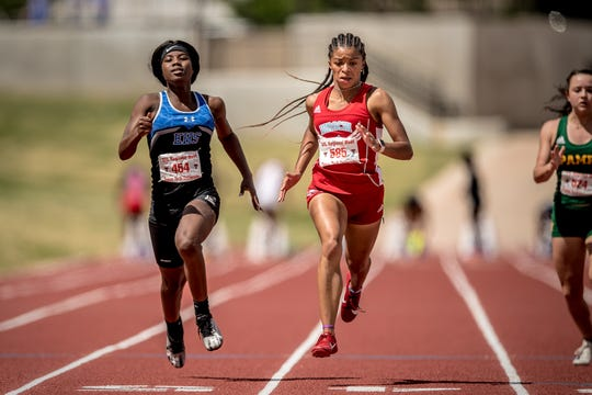 Hirschi's Breonna Campbell holds off Lubbock Estacado's Za'Kaja Neloms to win the I-4A girls 100 Saturday.