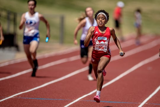 Hirschi's Ashton Carter crosses the finish line in second as the Lady Huskies earned a state berth and silver medal Saturday at the I-4A Meet.