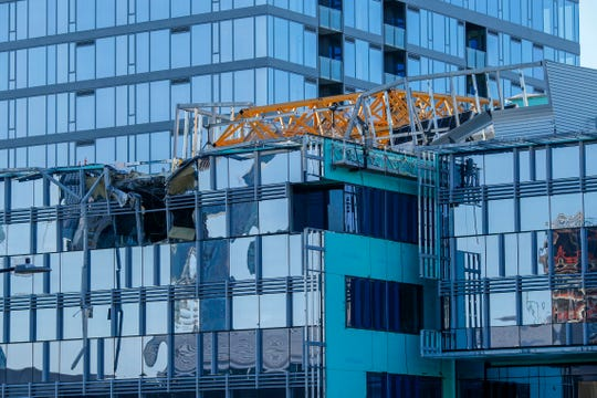 Emergency crews work at the scene of a construction crane collapse where several people were killed and others were injured Saturday, April 27, 2019, in the South Lake Union neighborhood of Seattle. The crane collapsed near the intersection of Mercer Street and Fairview Avenue near Interstate 5 shortly after 3 p.m.
